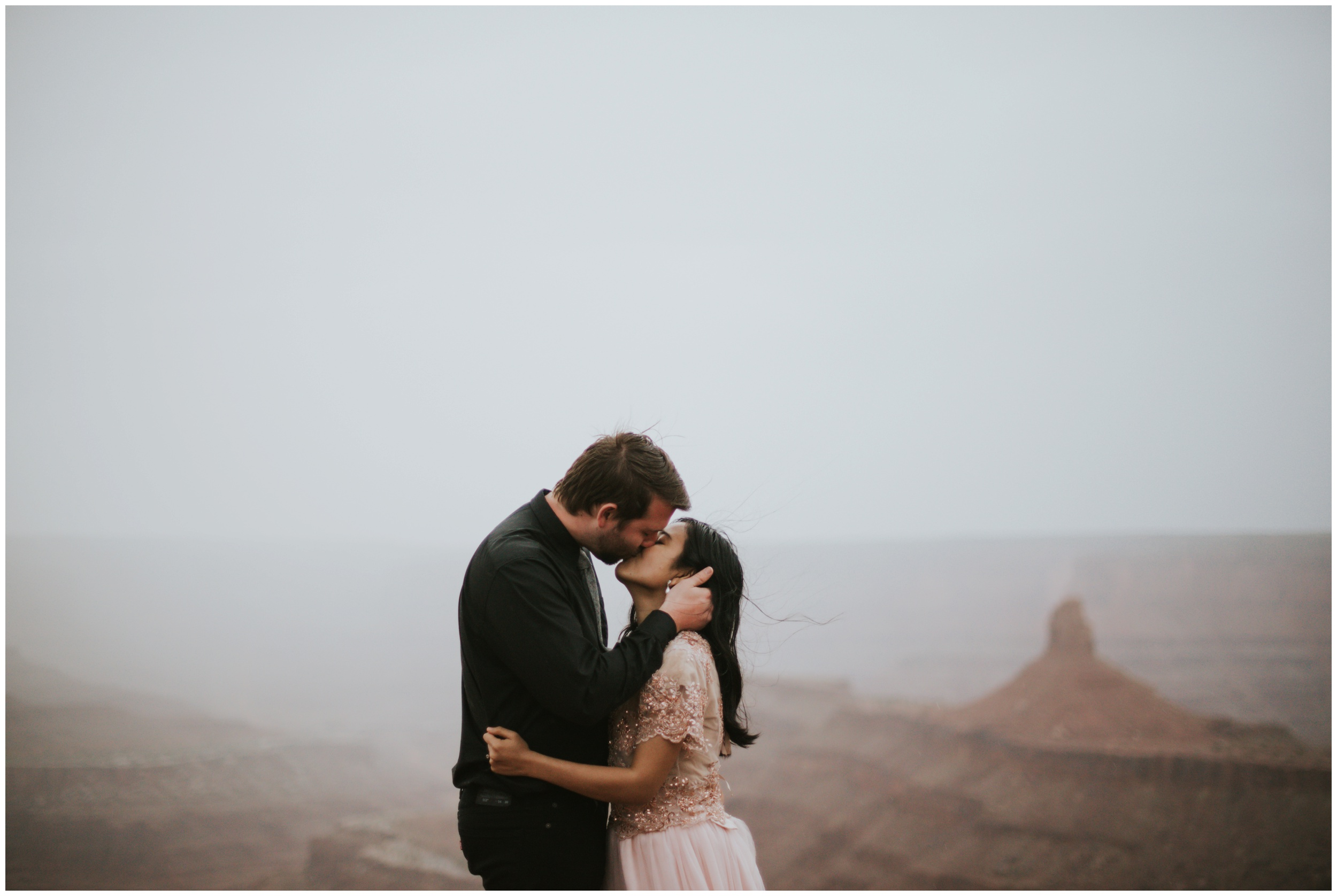 bride and groom kissing each other ontop of mountain at dead horse point state park | Elopement Photographer www.riversandroadsphotography.com