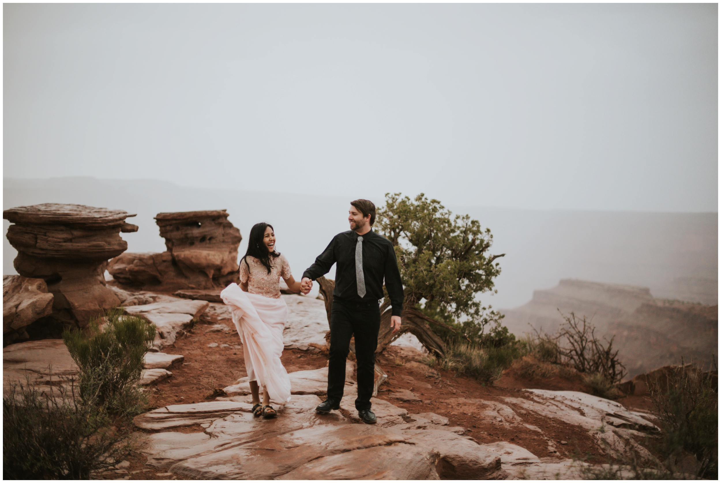 bride and groom running in the rain at dead horse point state park | Elopement Photographer www.riversandroadsphotography.com