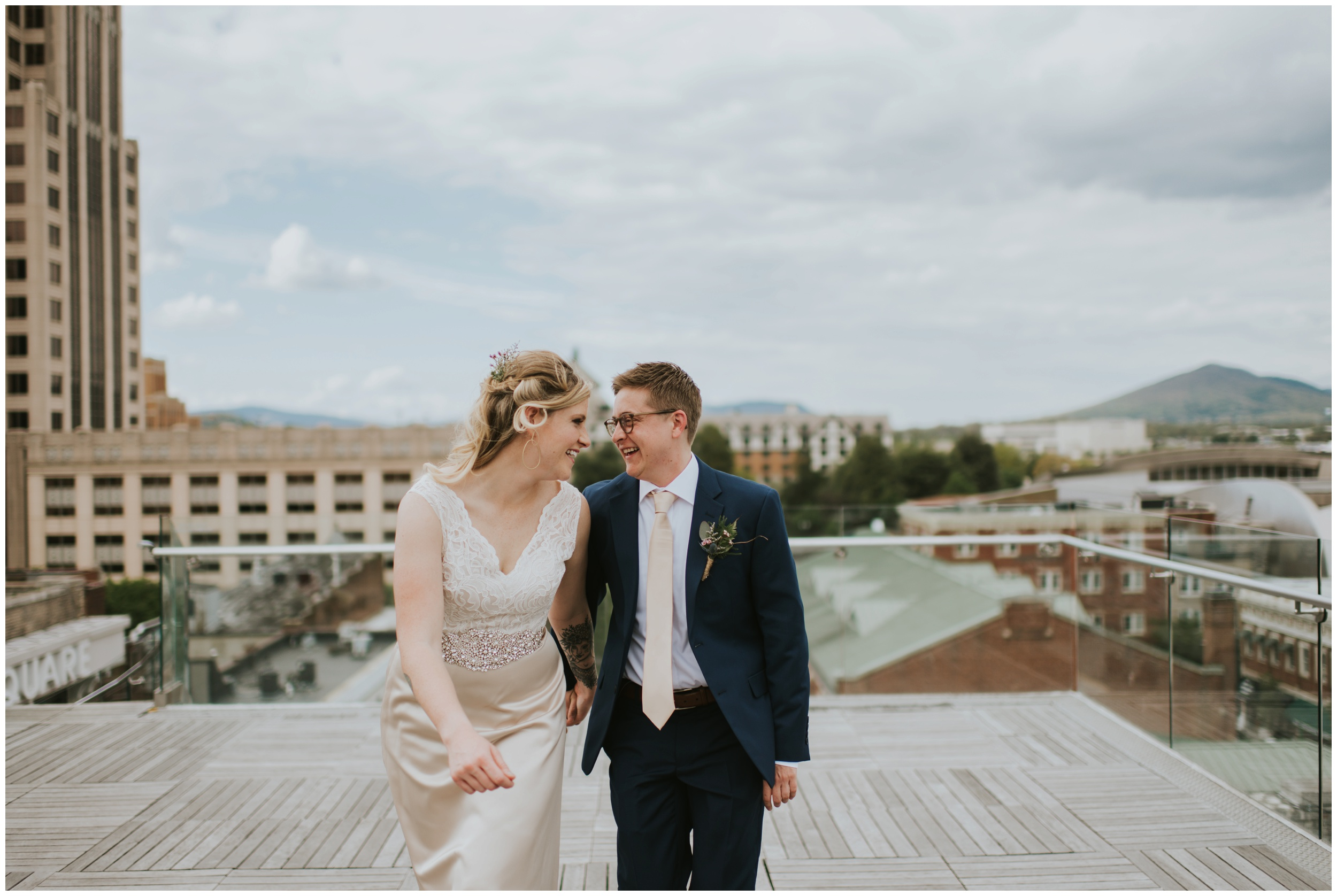 Couple laughing and walking on rooftop, downtown roanoke wedding  | www.riversandroadsphotography.com