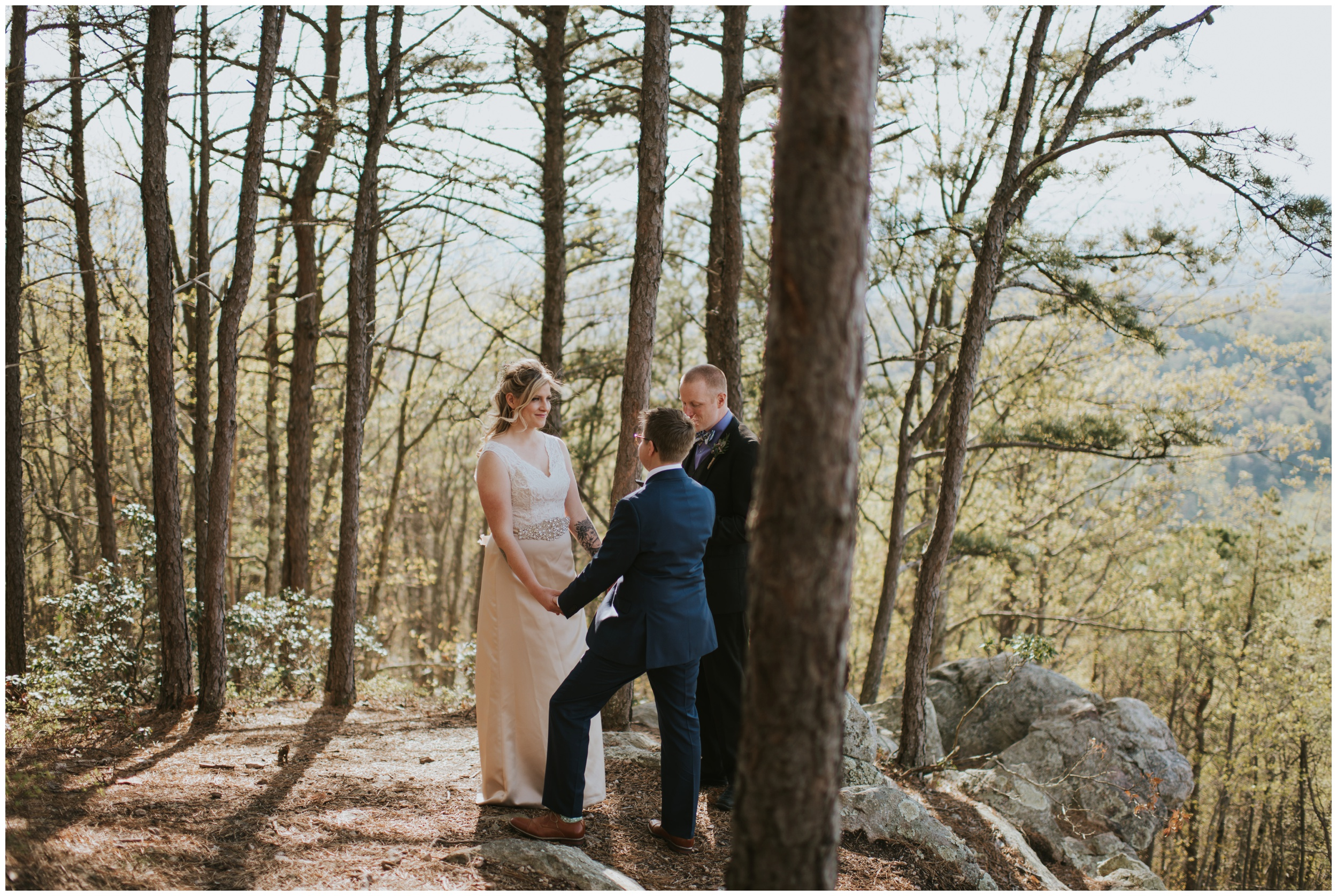 Couple sharing intimate vows ontop of Roanoke Mountain Overlook | www.riversandroadsphotography.com