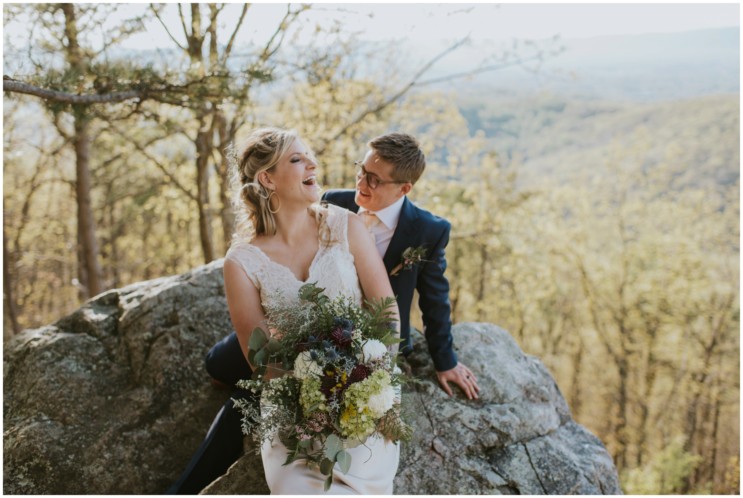 couple laughing ontop of roanoke mountain in Virginia, just married! | www.riversandroadsphotography.com