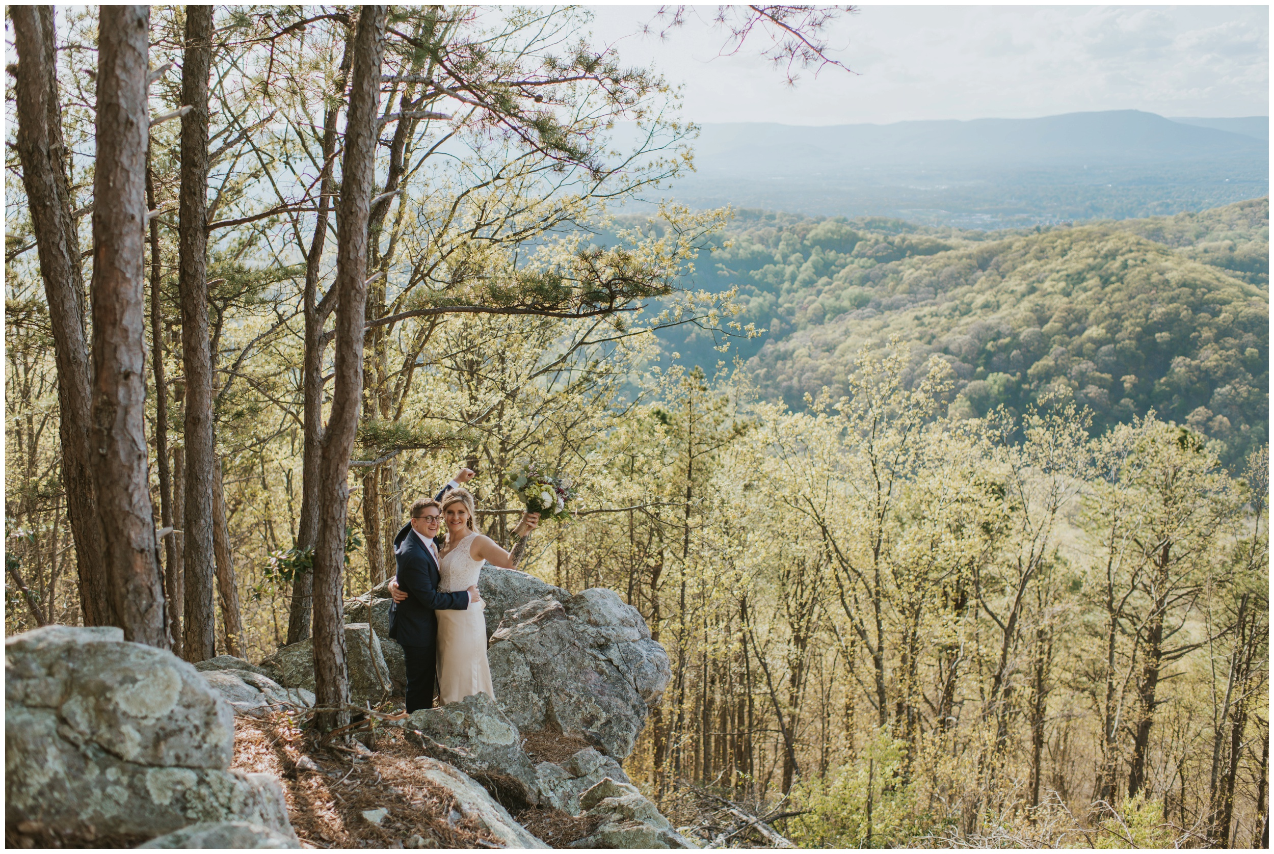 couple celebrating ontop of roanoke mountain overlook | www.riversandroadsphotography.com