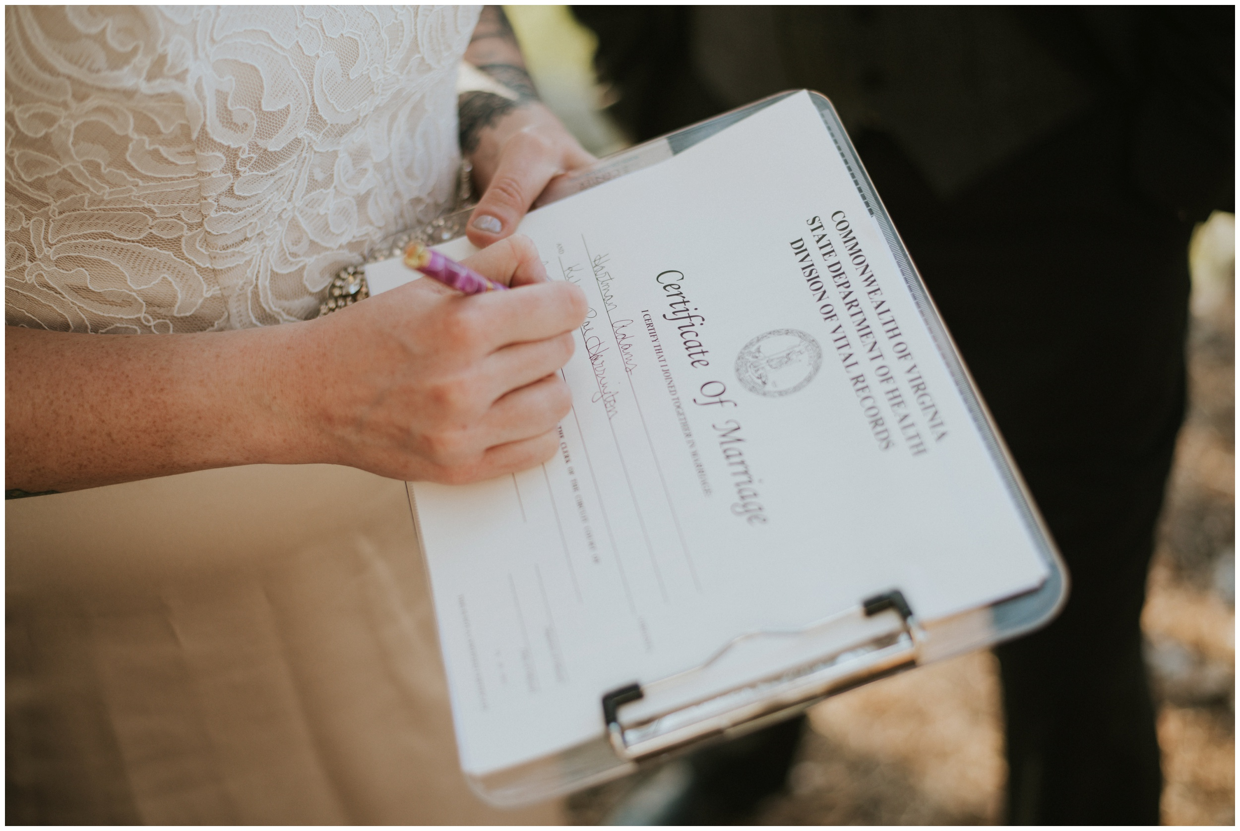 Signing the marriage license after eloping  | www.riversandroadsphotography.com