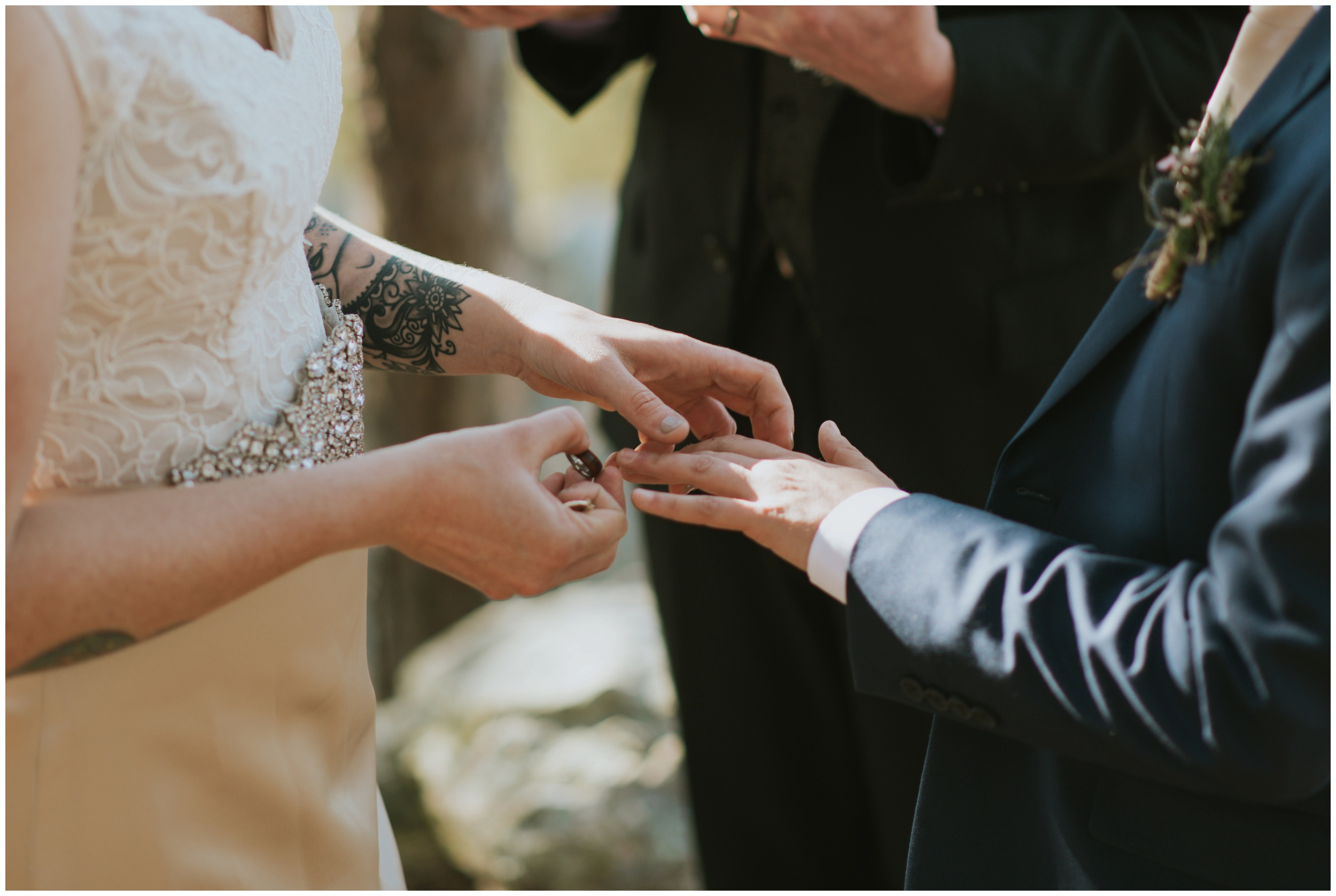 exchanging of rings during outdoor ceremony | www.riversandroadsphotography.com