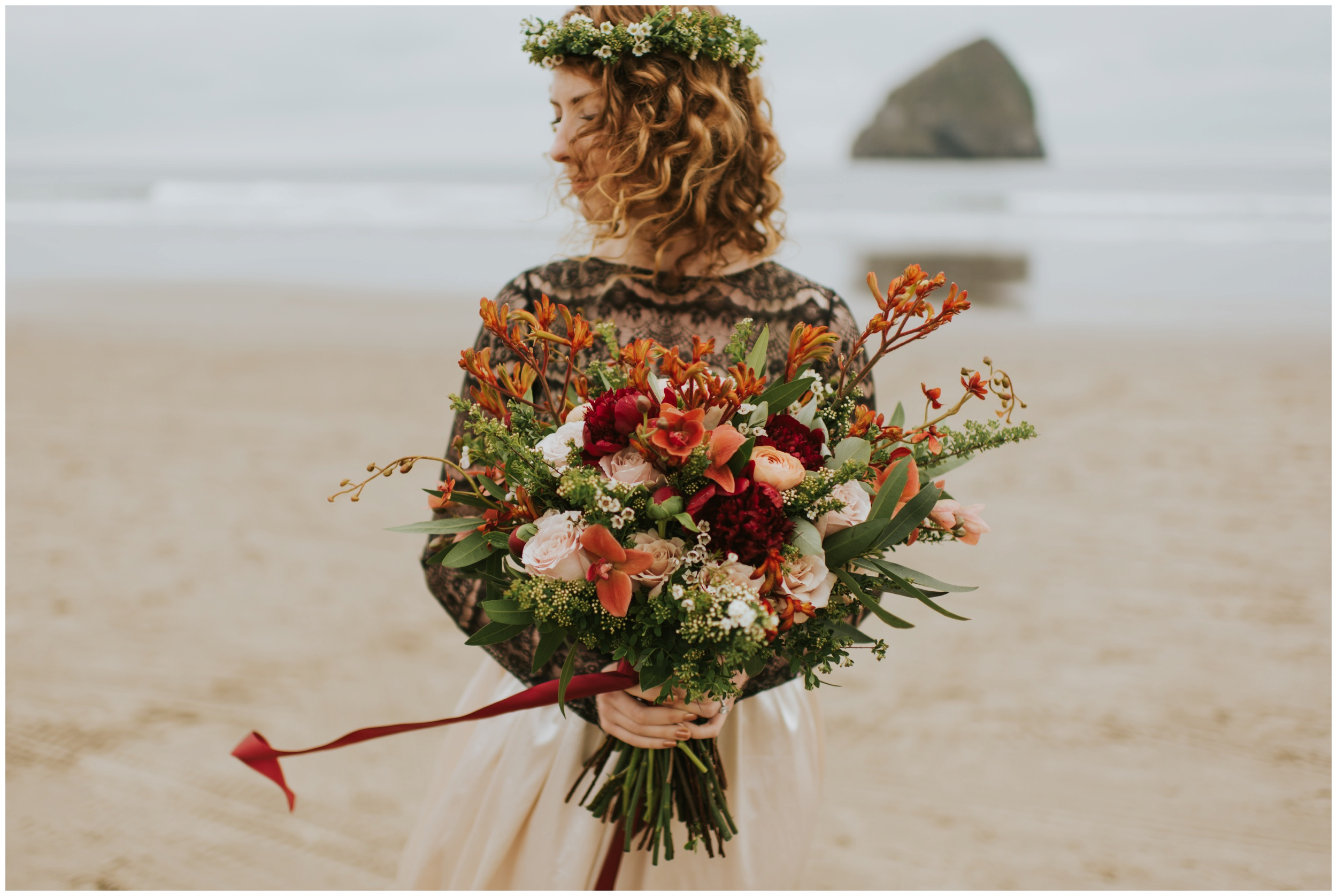 Bride holding bouquet on the bridepacific coast | Oregon Wedding Photographer www.riversandroadsphotography.com