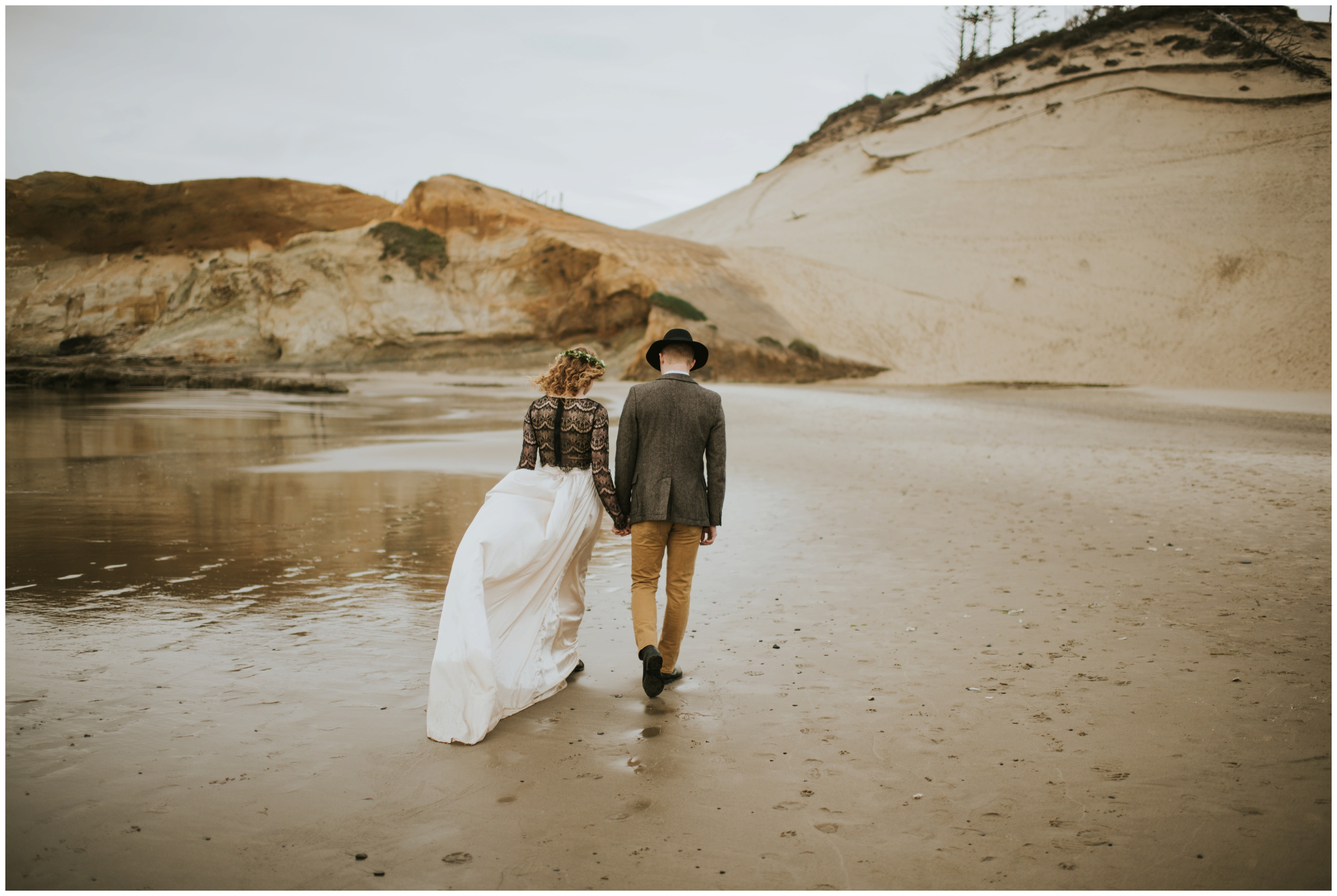 bride and groom walking towards sand dunes at cape kiwanda  | Pacific City Wedding Photographer www.riversandroadsphotography.com