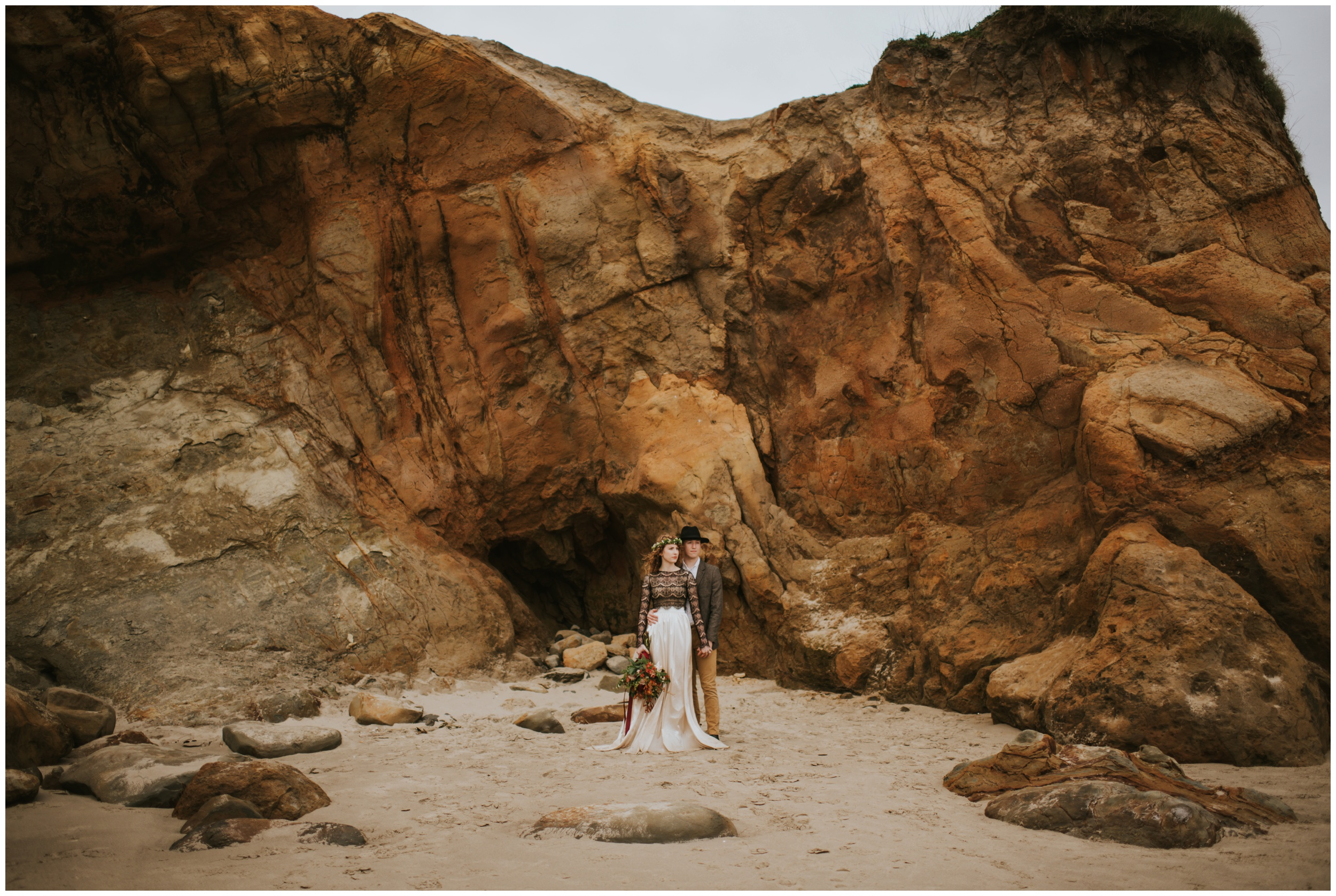 bride and groom at the rock formations on the beach at cape kiwanda  | Pacific City Wedding Photographer www.riversandroadsphotography.com