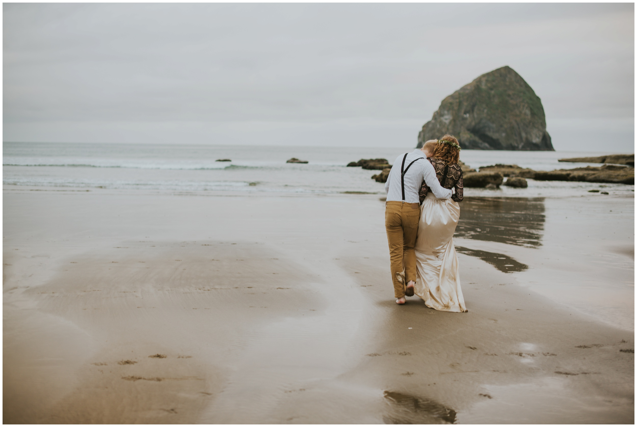 cape kiwanda playing in the ocean  | Pacific City Wedding Photographer www.riversandroadsphotography.com