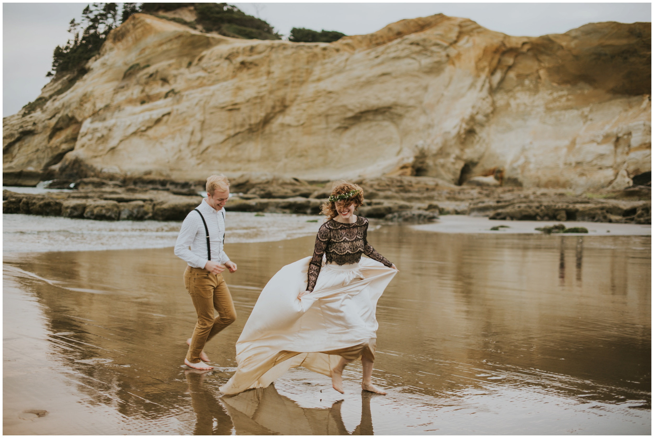 bride running on the beach at cape kiwanda