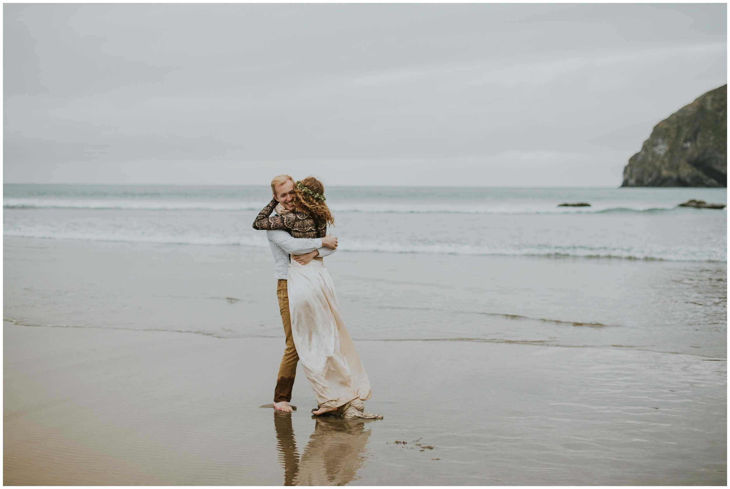 bride and groom playing in the ocean  | Pacific City Wedding Photographer www.riversandroadsphotography.com