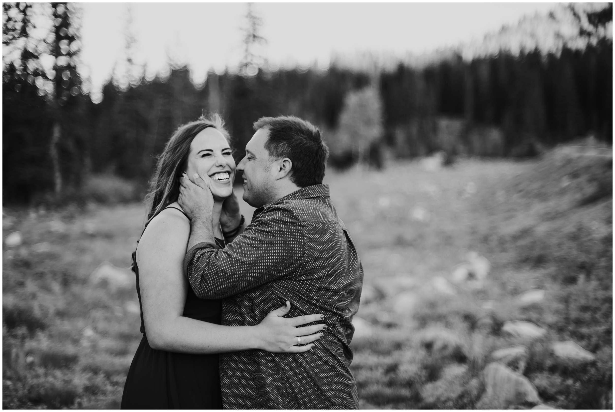 couple laughing, black and white engagement photos