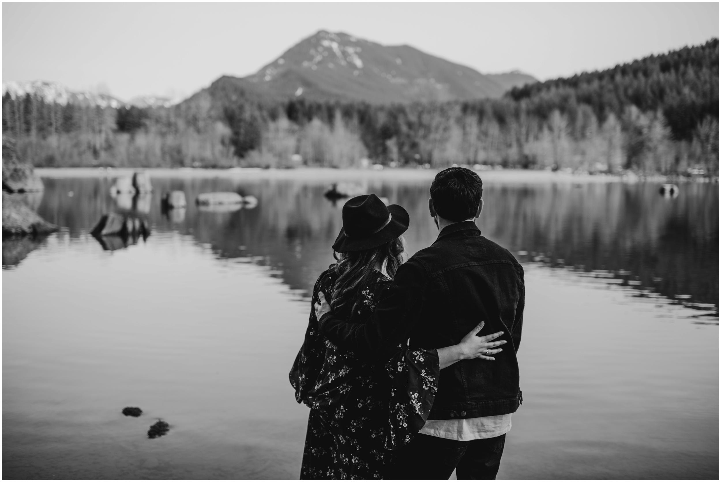 couple looking over the water Rattlesnake Lake, WA   Seattle Wedding Photographer www.riversandroadsphotography.com