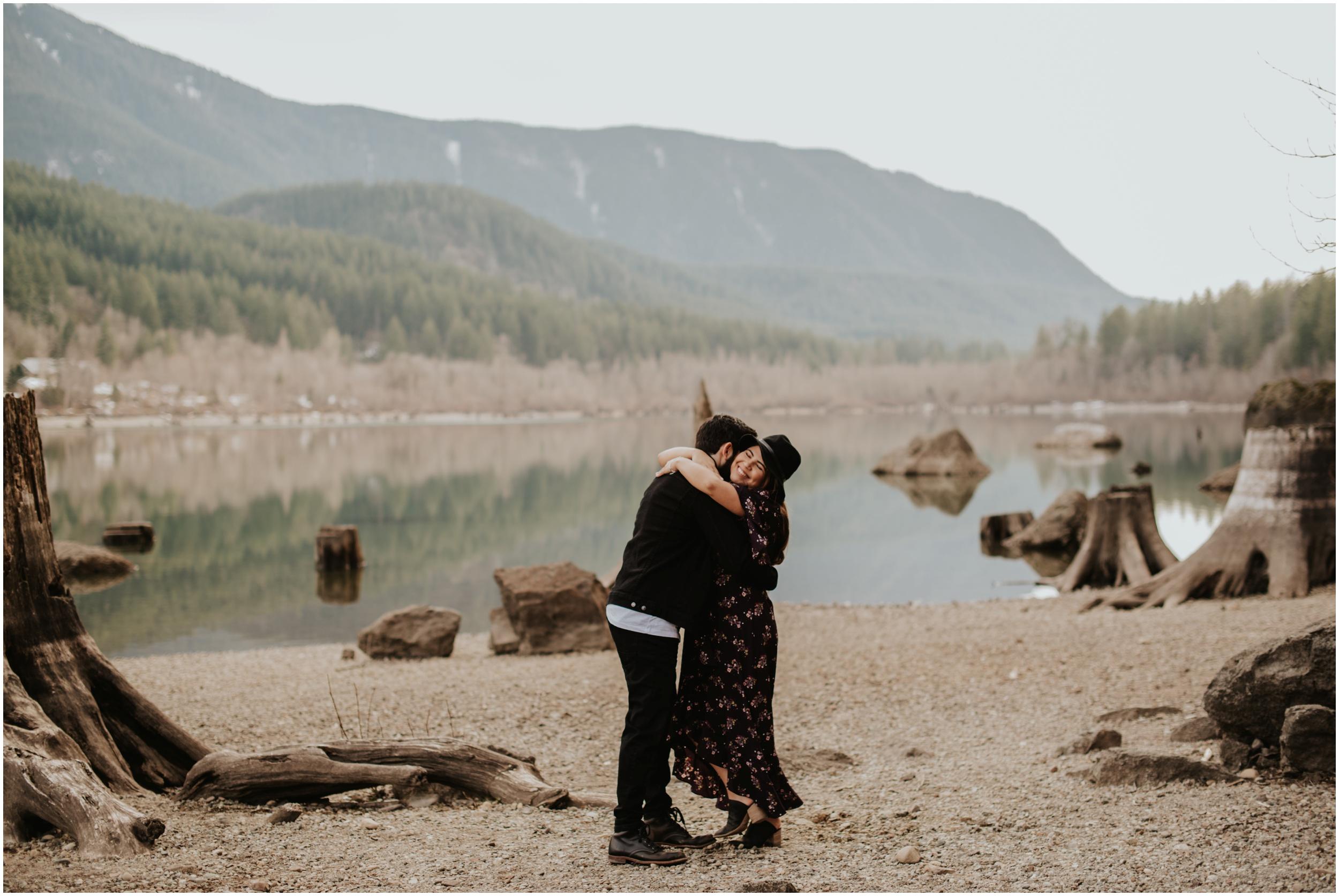 couple hugging Rattlesnake Lake, WA | Seattle Wedding Photographer www.riversandroadsphotography.com