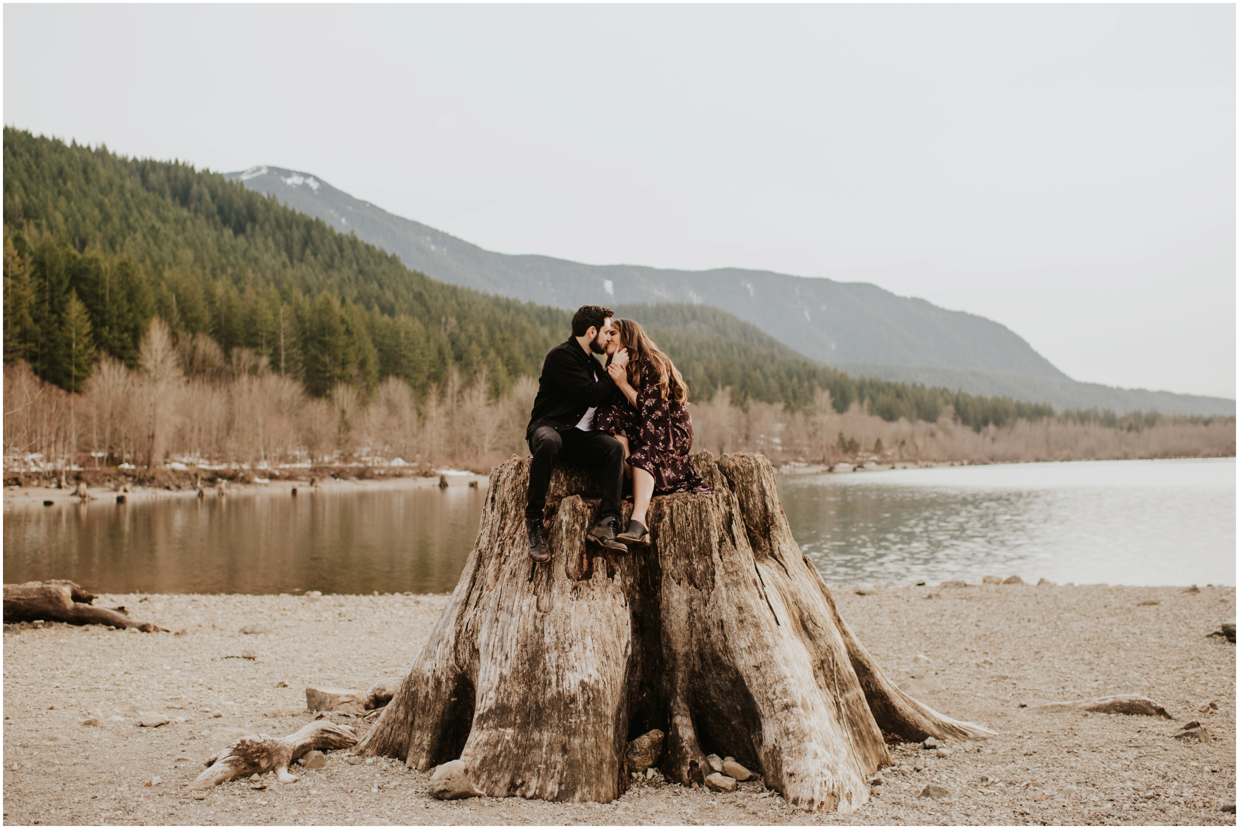 couple cuddling on tree Rattlesnake Lake, WA | Seattle Wedding Photographer www.riversandroadsphotography.com