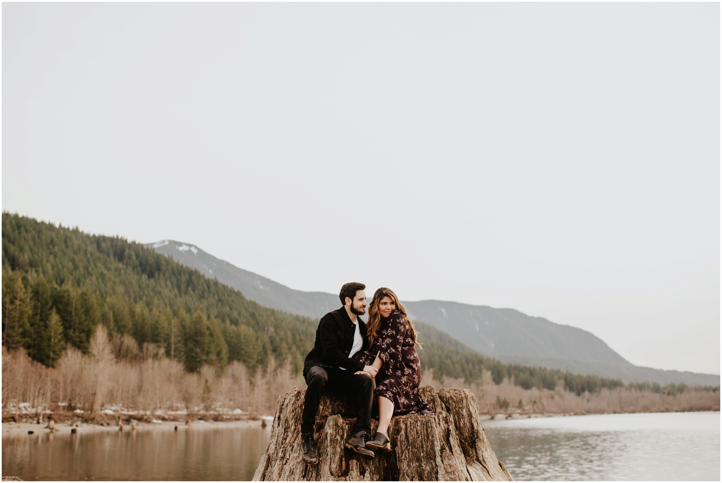 Couple on tree trunk at Rattlesnake Lake, WA | Seattle Wedding Photographer www.riversandroadsphotography.com