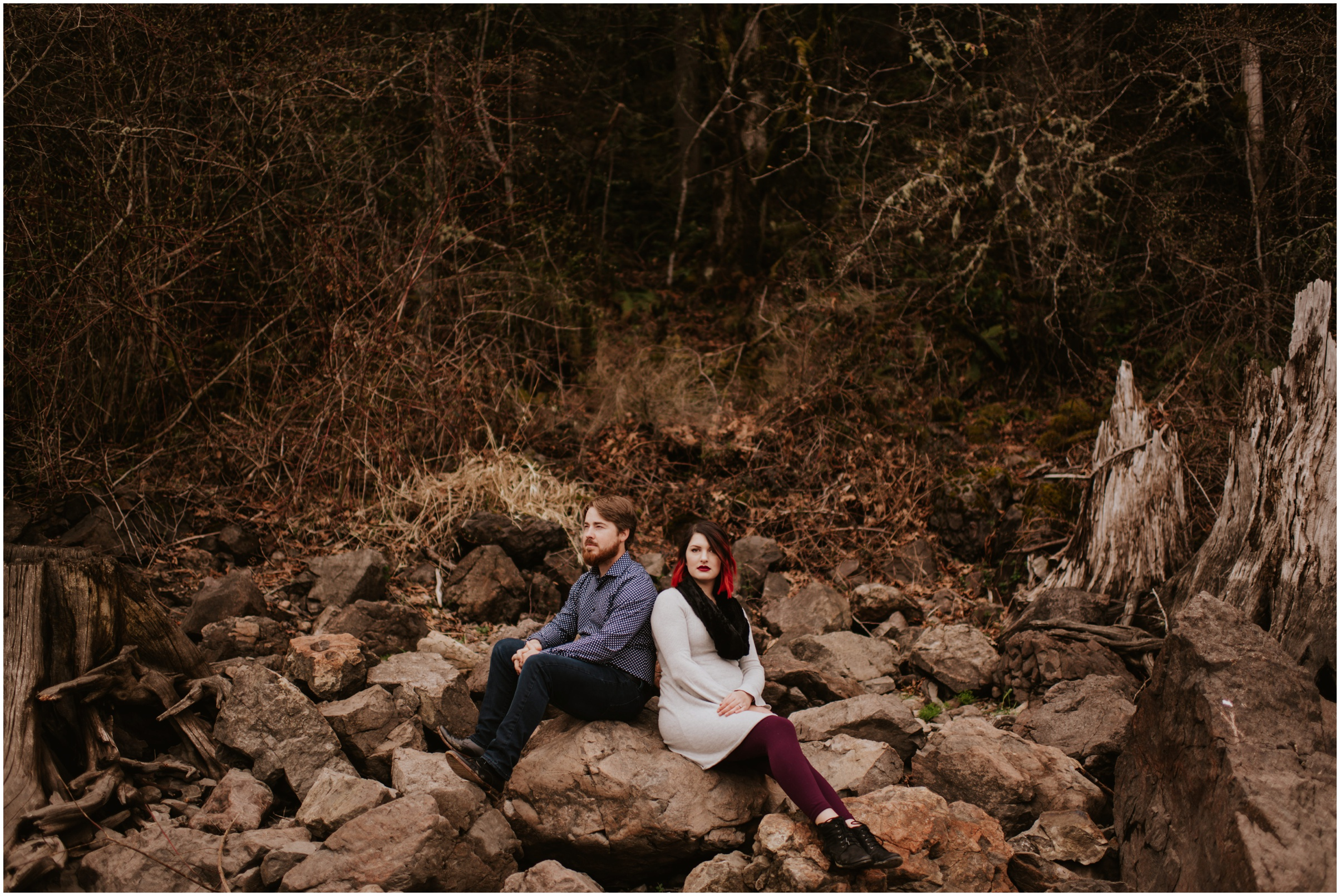 Couple modeling on rocks at Rattlesnake Lake, WA | Engagement Photographer Seattle www.riversandroadsphotography.com