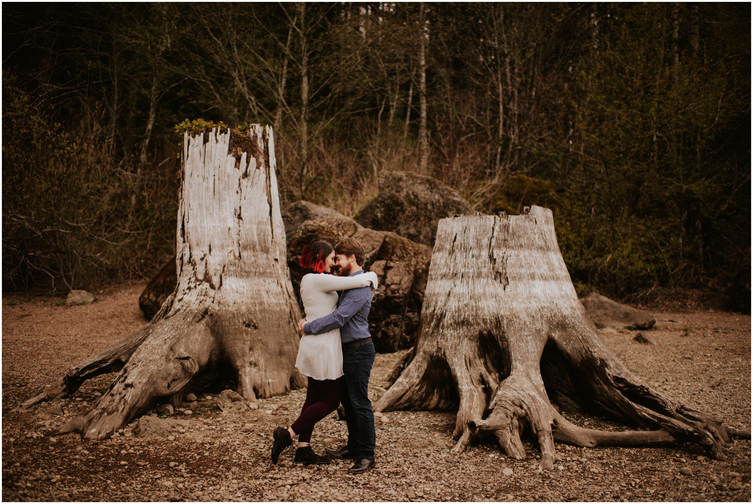 couple hugging beside trees Rattlesnake Lake, WA | Engagement Photographer Seattle www.riversandroadsphotography.comwww.riversandroadsphotography.com