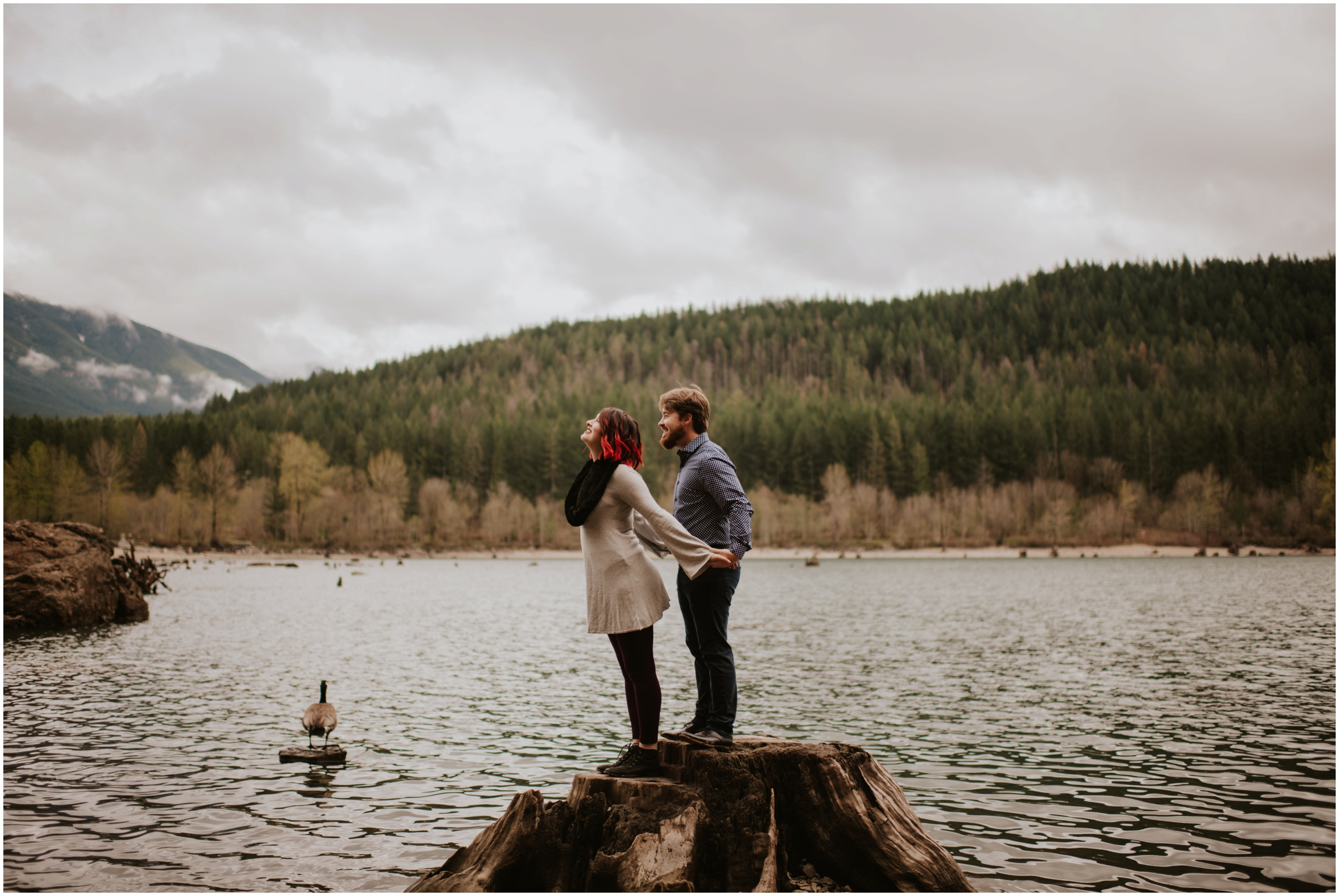 couple modeling at Rattlesnake Lake, WA | Engagement Photographer Seattle www.riversandroadsphotography.com