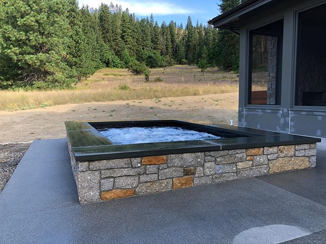 Our east of the mountains custom spa build is about complete. In love with the stone work that was chosen for the spa. #poolpro #customspa #spabuild #newspaconstruction #pnw #eastofthemountains #mountainspa #alpineviews