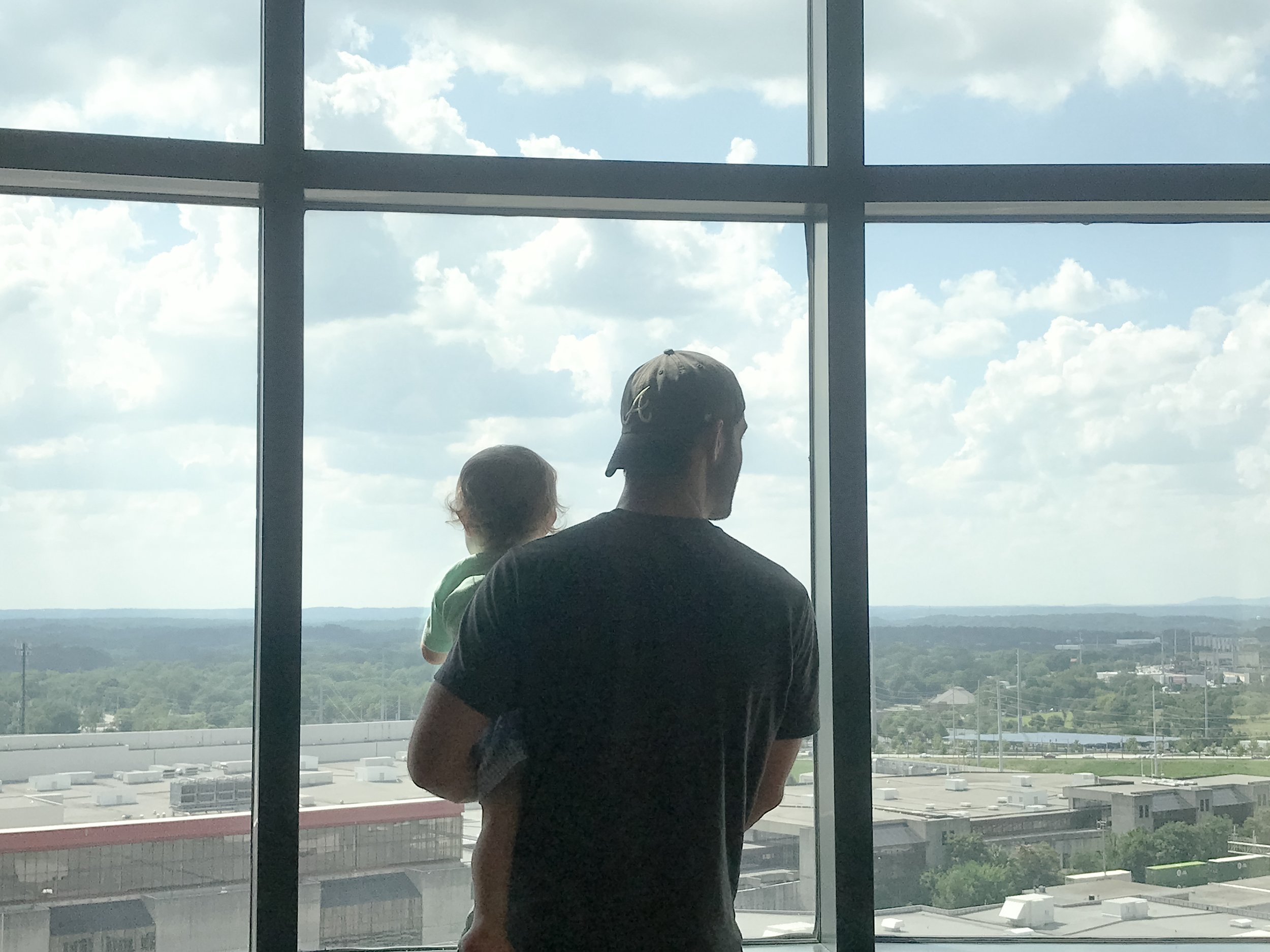 The only picture I took at the first hotel. We had a pretty neat view of the new Mercedes-Benz stadium, the Georgia Dome, and downtown. Also... look at that sweet Daddy's boy ;)