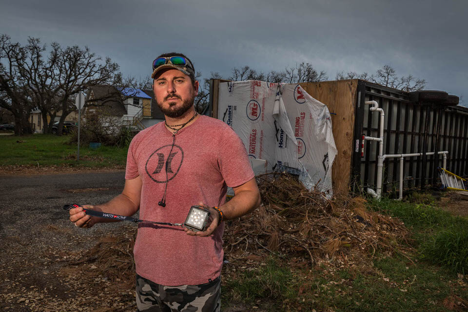 When we first met Josh he was helping his girlfriends grandma with her damaged house. When we asked him how his house was, he walked us over to his tiny house on wheels he was just in the process of completing. His tiny house can be seen overturned behind him was destroyed beyond repair.