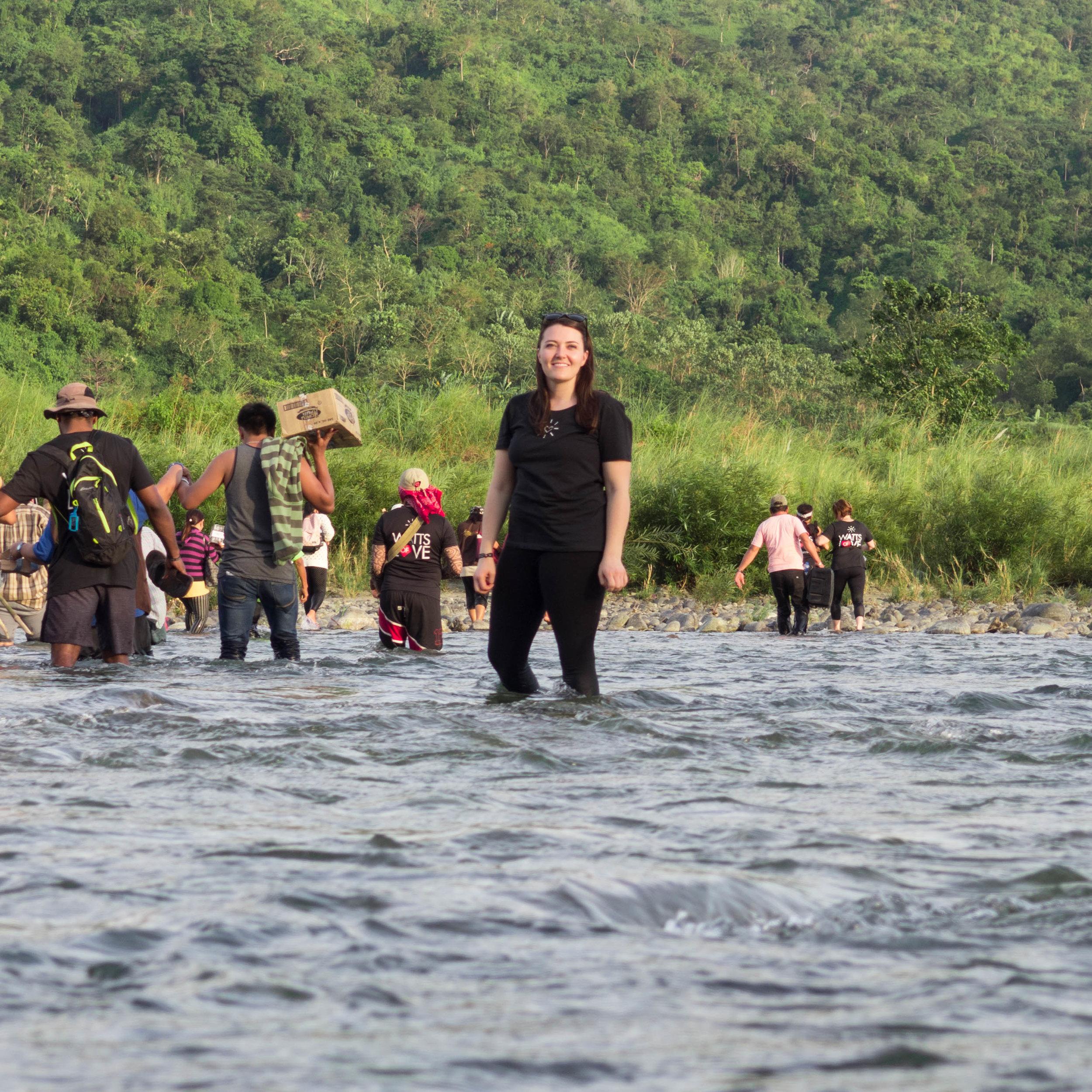 Kendra Hurst poses mid river crossing.