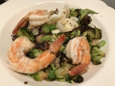 Quinoa bowl - with shrimp, fish, garlic, lemon, dried oregano, mushrooms, green onion, roasted broccoli and roasted shaved brussels sprouts.