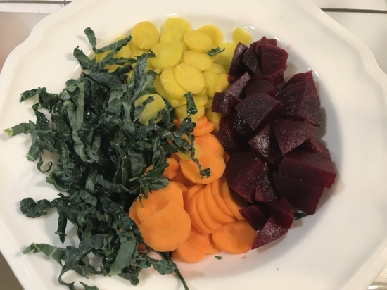 Thinly sliced kale, carrots (yellow and orange) and beets. I also love the golden beet variety.