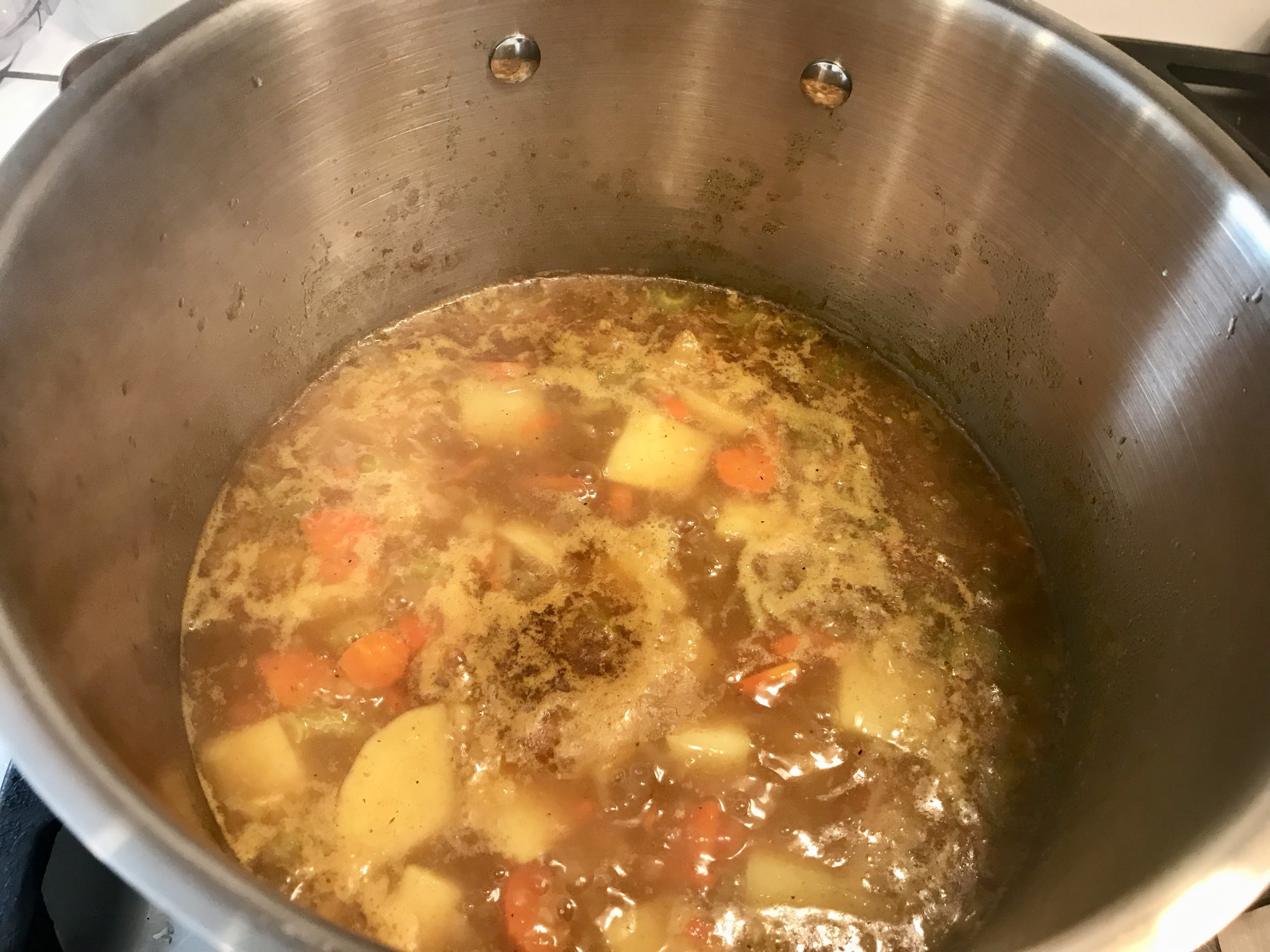 Add water (I used a reduced sodium vegetable broth and skipped the added salt) and bring to a boil, then simmer for 20 minutes or until veggies are soft. Add the cashew butter and coconut milk (I used reduced fat coconut milk) Blend until smooth with an immersion blender or transfer to a blender when soup has cooled a bit.
