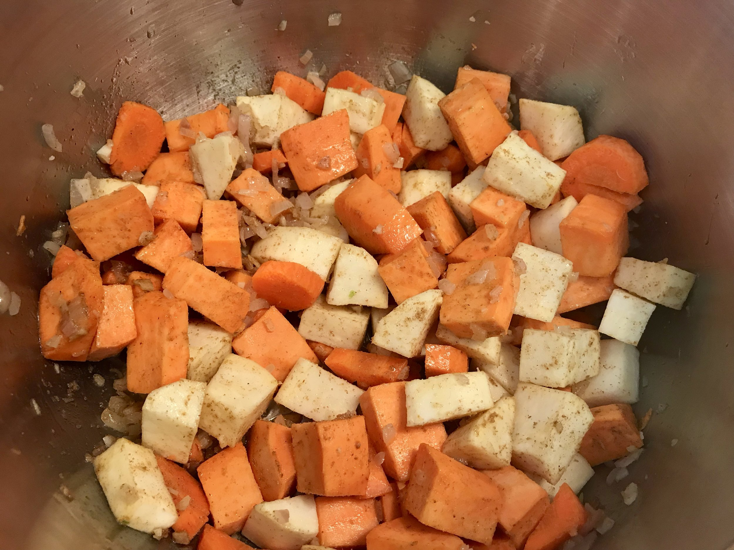 Add diced sweet potato( I used a combination of light and orange sweet potatoes) and spices and stir to combine. I also added a carrot here.