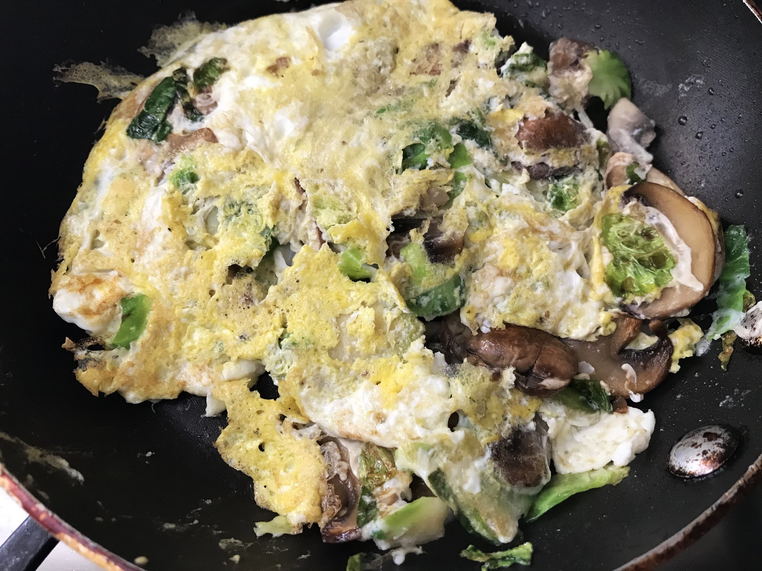 Add 1 egg and 1 egg white and scramble. I don't care so much to make a beautiful omelette, just scramble it and flip it over!