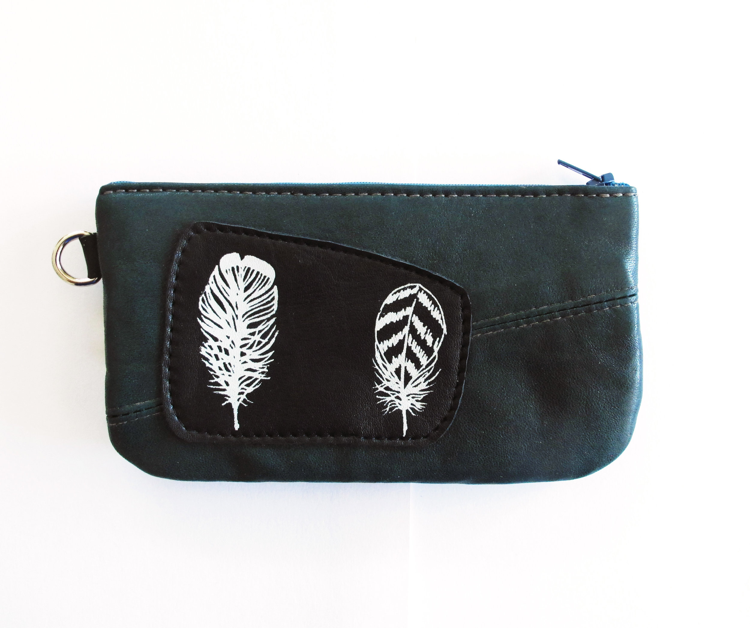 Feathers on Bonspiel Leather