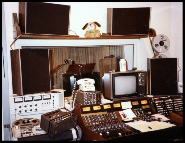 Around 1982 -Sitting on the 4 track machine on the left is the remote for the MCI 8 track which is in the back of the room. There are 2 additional MDM monitors sitting under the speaker shelf, this is not a normal situation but an experiment, most likely during a session with John Klett. That would be the corner of his Linn Drum Machine on the extreme right.