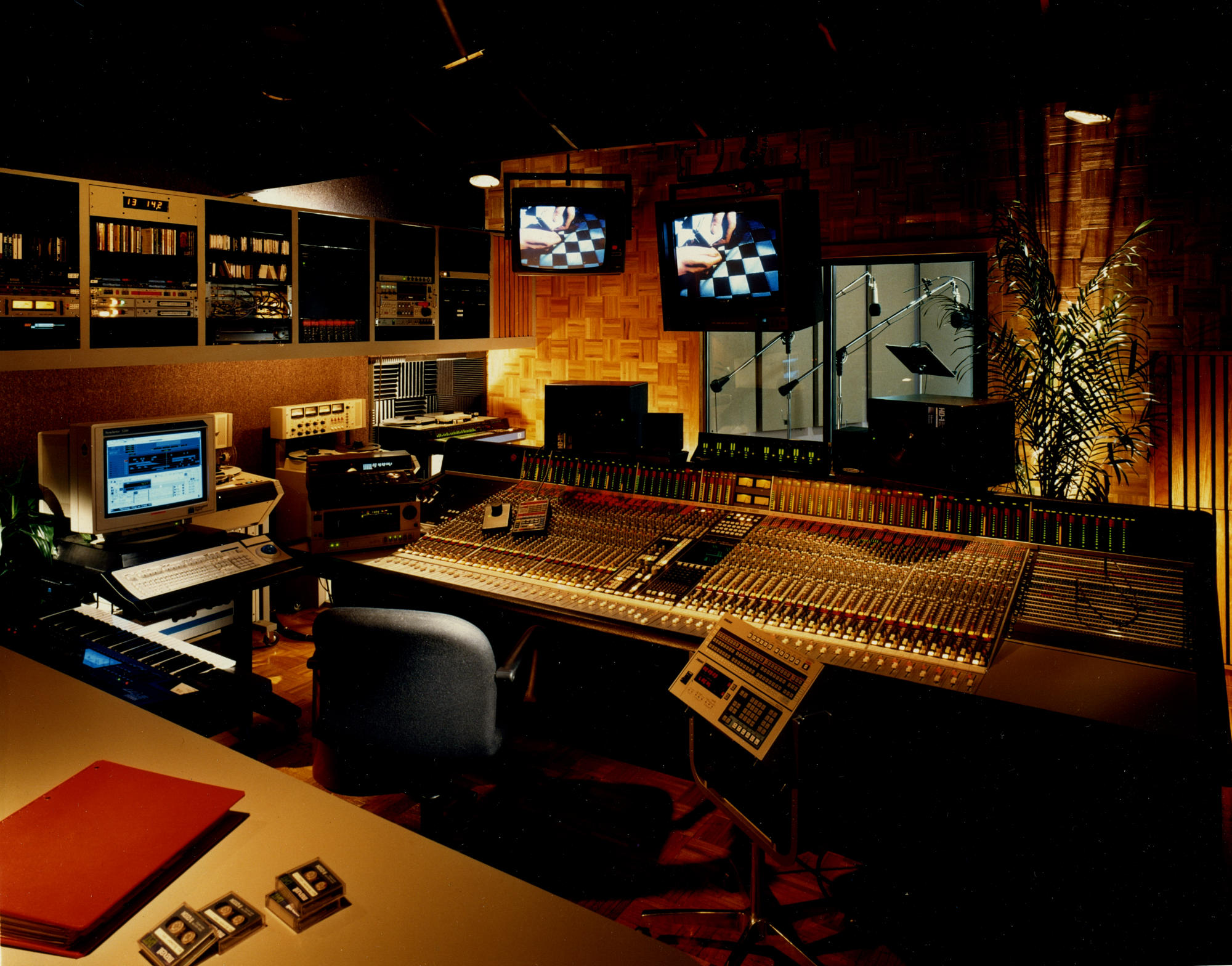 "Similar to the setup at East Side Film and Video here's my home at the time - Studio 4 at National Video Center in NYC around 1992 (where the remix for Steinski and Mass Media's ""It's Up To You"" was made). An SSL 4000 console, 32 voice 16 track Synclavier, Sony 3324 digital 24 track, Meyer HD-1 speakers and a tv monitor that lowered from a garage door opener: 0ver $600K spent here! It never fails to amaze me that I now have even more power on a Macbook Pro then I did then. Even my Ipad can do greater audio manipulation. So you can imagine how glad I am it wasn't my money spent on all that gear. It was a good time for leasing companies!"