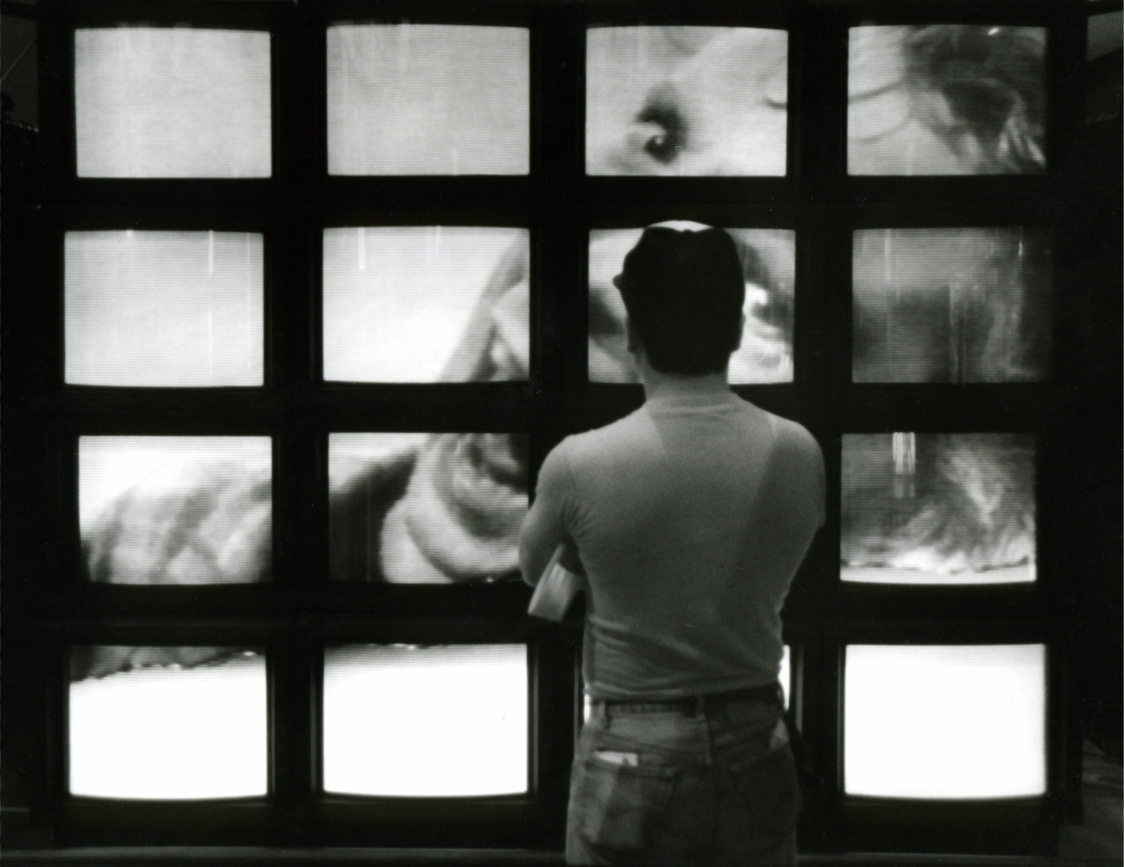 "Rubin D. Herrera watches the ""breathing"" video wall at the MTV Museum of UnNatural History. photo - Carlos Antonio Rios, Houston Chronicle © 1988  From the Houston Chronicle March 25, 1988"