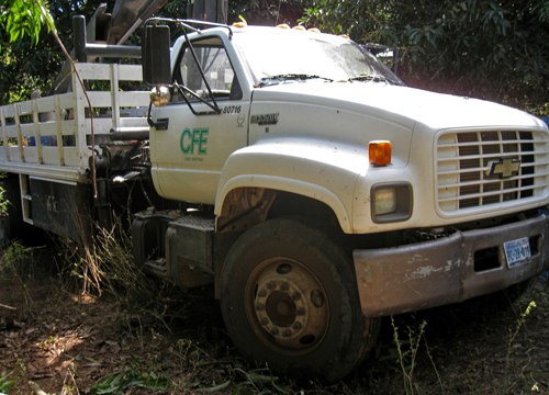 CFE Truck in the Jungle. This truck has a winch for tightening the cables onceon the poles.