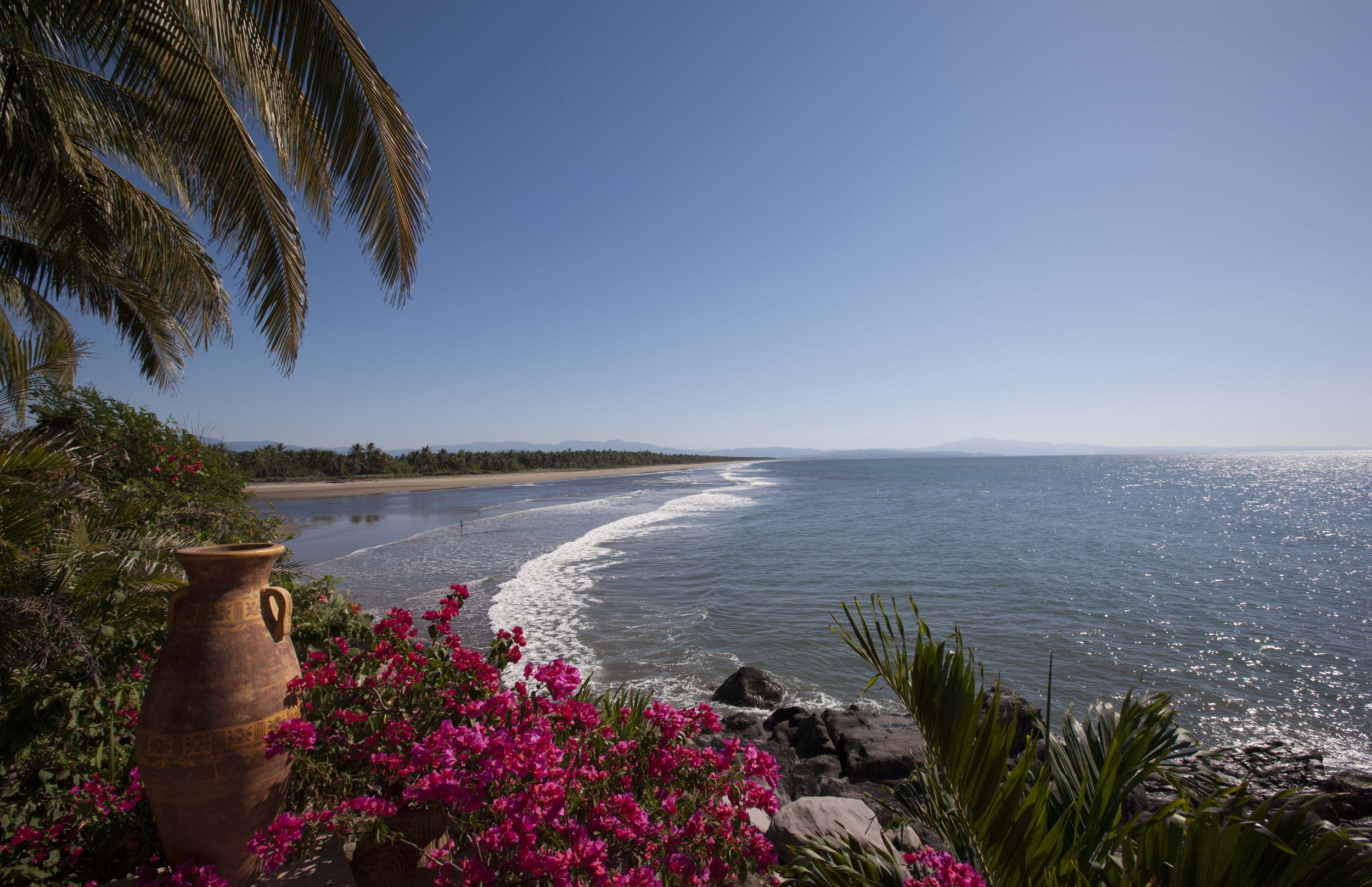 Low tide: looking south across turtle beach. Beyond the distant mountain range is puerto vallarta.