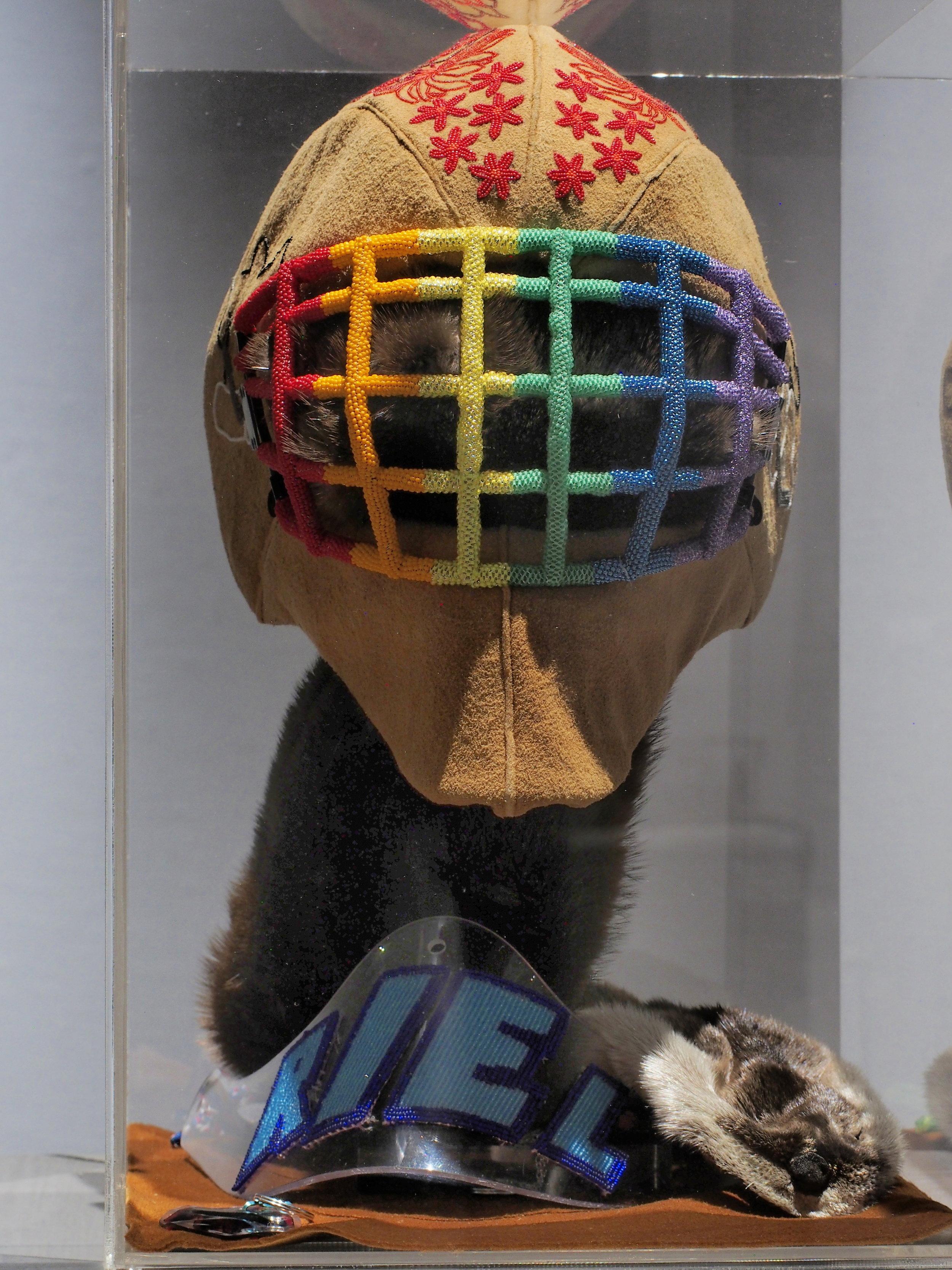 Judy Anderson,  This one brings me the most pride,  2016, beads, moose hide, goalie helmet, plexi, otter pelt.