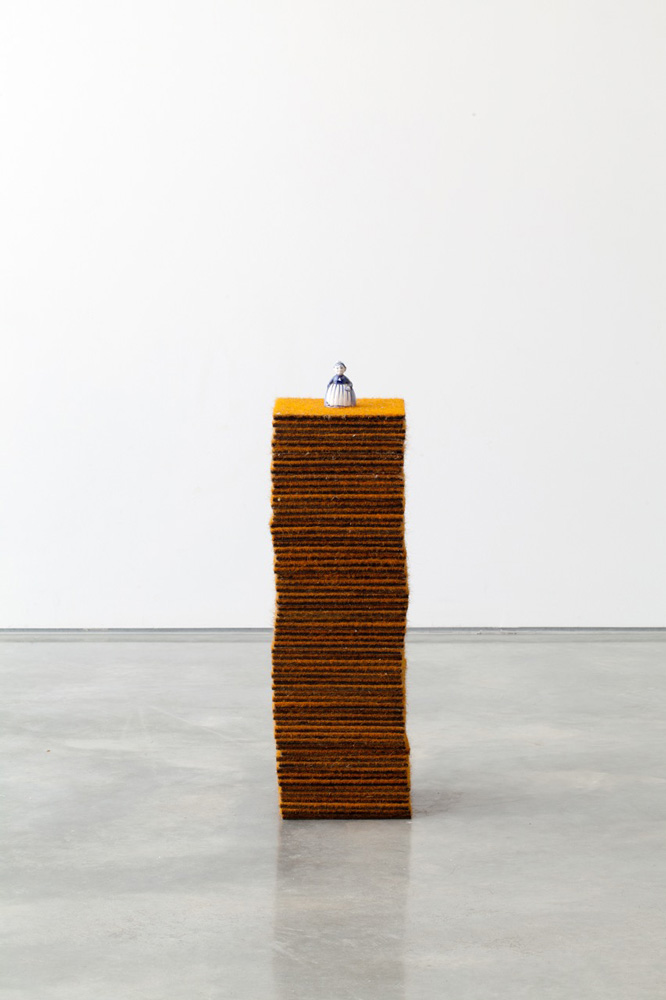 Koji Ryui,  Bell , 2014, carpet squares, found ceramic bell, stud adhesive, air drying clay, 57 x 17 x 17cm. Image courtesy the artist and Sarah Cottier Gallery