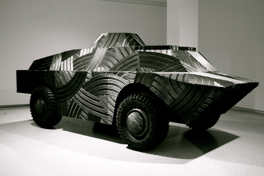 Brett Graham,  Mihaia , 2010, MDF board, tyres. 679 x 691 x 1692 inches