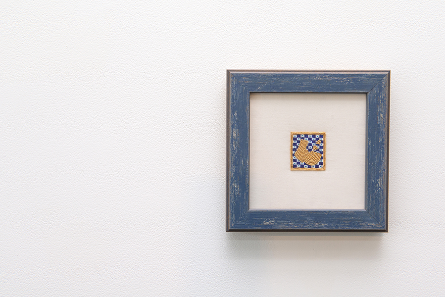 Capped Manuscript Illumination…Indigenized (L) , 2016, 24K gold plated beads, glass beads 3.8 x 4.8cm. In collaboration with Cruz Anderson