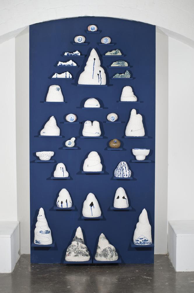Robyn Phelan,  Porcelain Wall , 2010, Ceramic, tissue decals, timber, pigment, 240 x 122 x 45cm