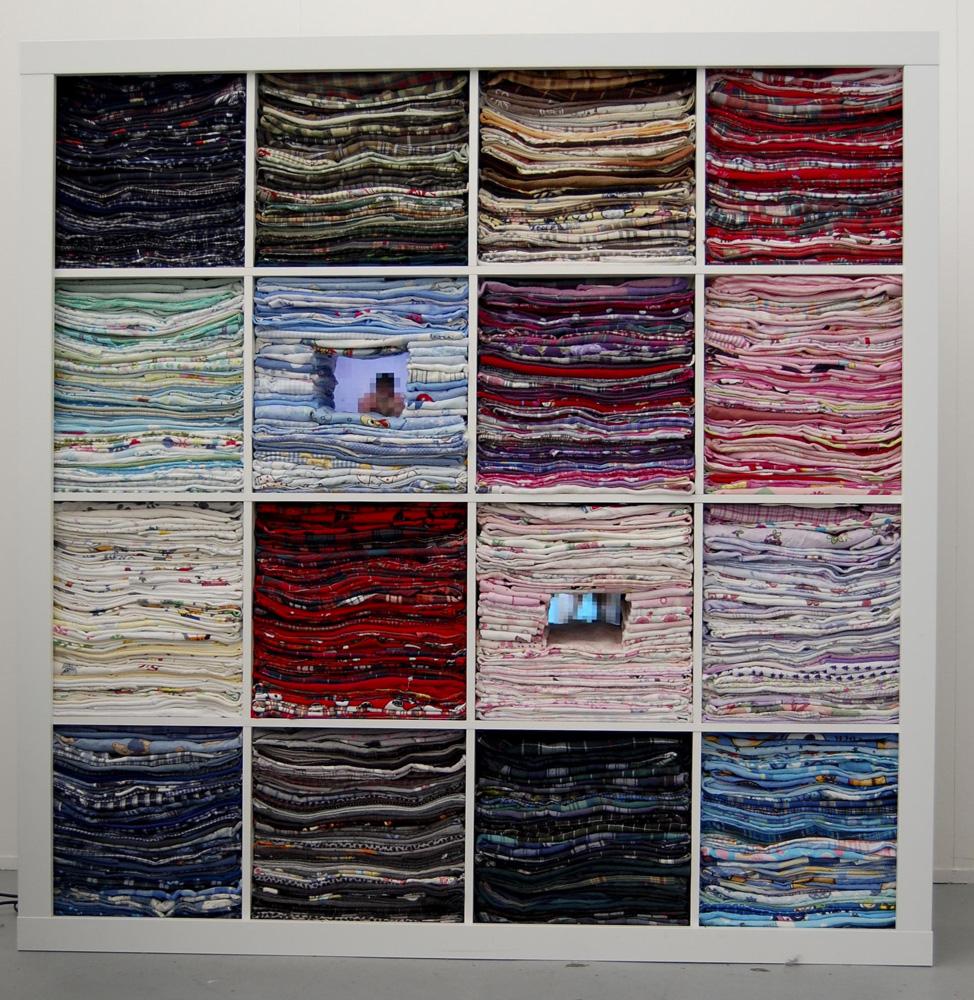 Caitlin Telford,  Encoded Cavities , 2010, Chipboard, fabric, video, 135 x 165 x 31 cm