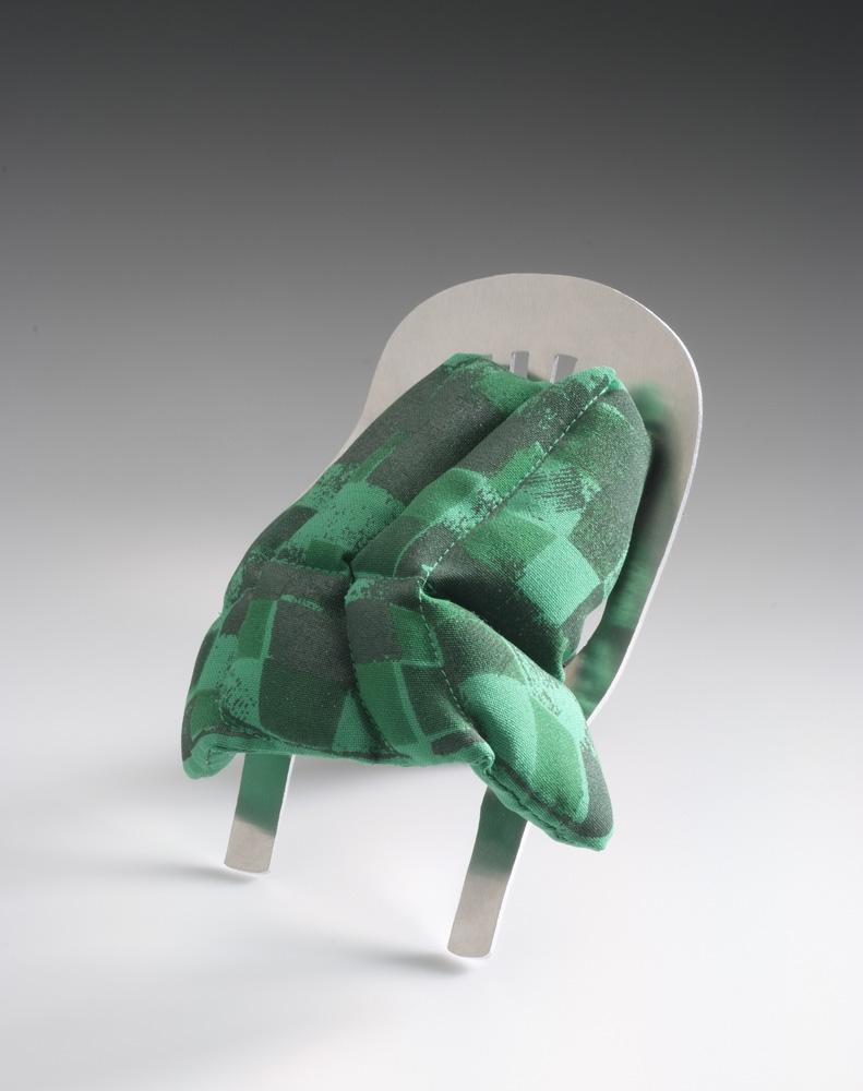 Ineke Heerkens,  Brooch Stocky green,  2007, Aluminum, textile, silkscreen-print, 100 mm x 155 mm x 50 mm, Image courtesy the artist and Galerie Marzee, Nijmegen, The Netherlands, Photography by Tom Haartsen