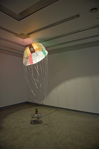 Jaffa Lam,  Parachute , 2010. Work for 8 March: Landing in different art venues during March. From the series Micro Economy.