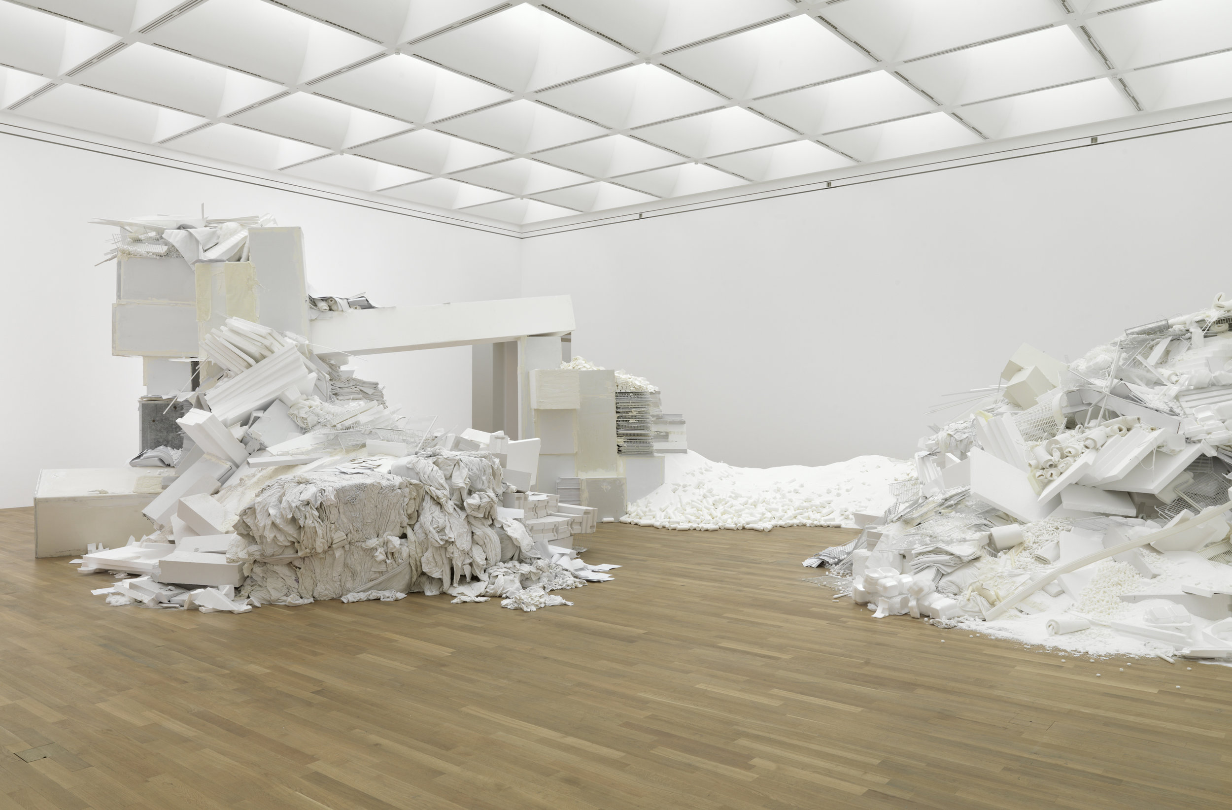 Thomas Rentmeister,  Muda , 2011, various materials (incl. refrigerators, Penaten baby cream, Styrofoam, laundry, sugar, paper, flour, candles, plastic parts, tissues, cotton swabs, tampons, washing powder), approximately 385 x 1195 x 1145 cm. Exhibition view Kunstmuseum Bonn. Photo: Berndt Borchardt. Image Courtesy of the Artist and GAGPROJECTS, Adelaide.