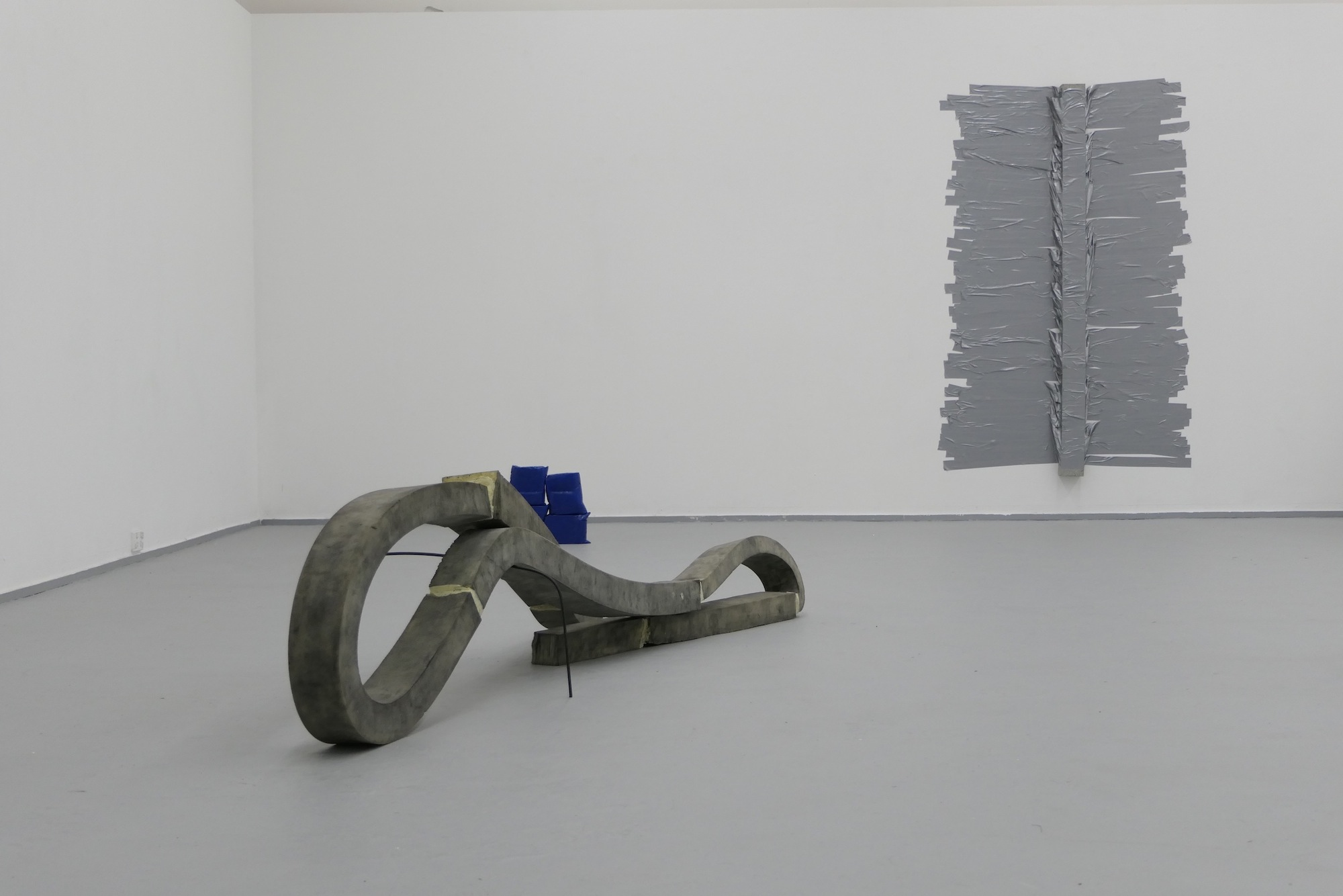 Isabel Buck,  Close Encounters,  2018, concrete, foam, metal, spray paint, oxide, found objects, packing and duct tape, dimensions variable.
