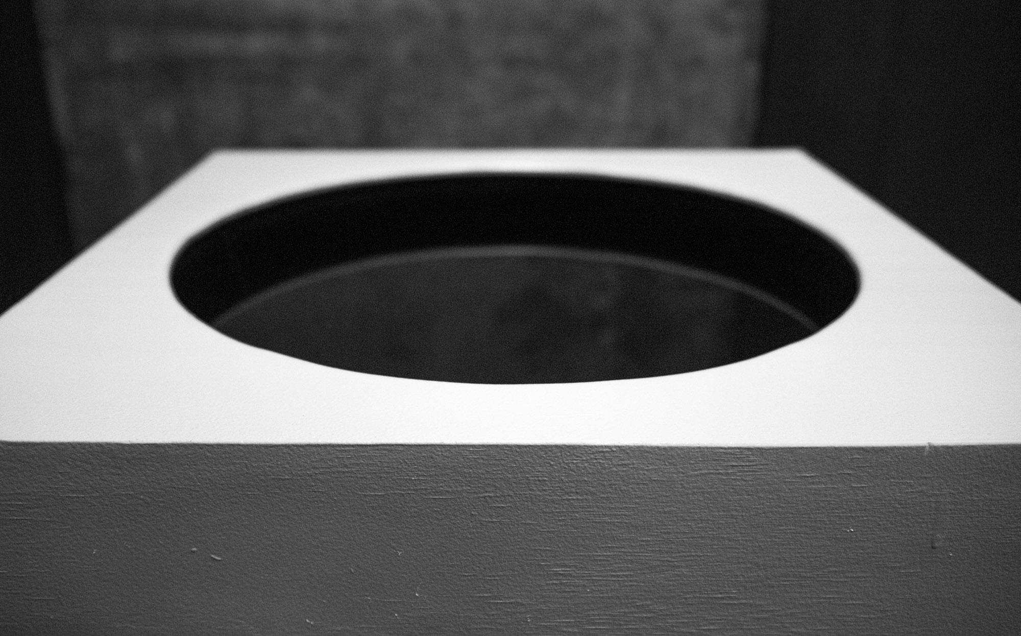Sara Retallick,  Portal , 2018, 2-channel underwater  sound, transducers, electronics, wooden plinth, warm water, plastic drum, 9 min variation on loop, 1120 x 600 x 600 mm
