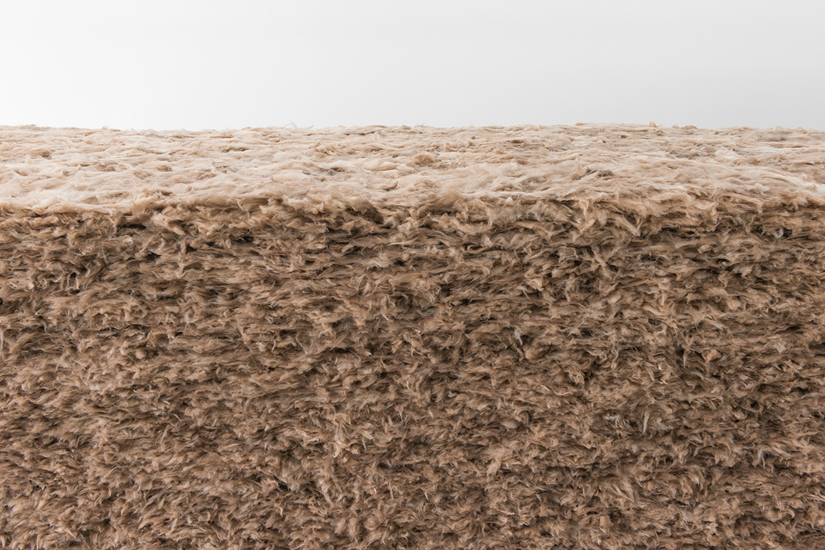 Thomas Rentmeister, Terra Mollis, 2019,  Ecological mineral wool, 120 x 540 x 253 cm