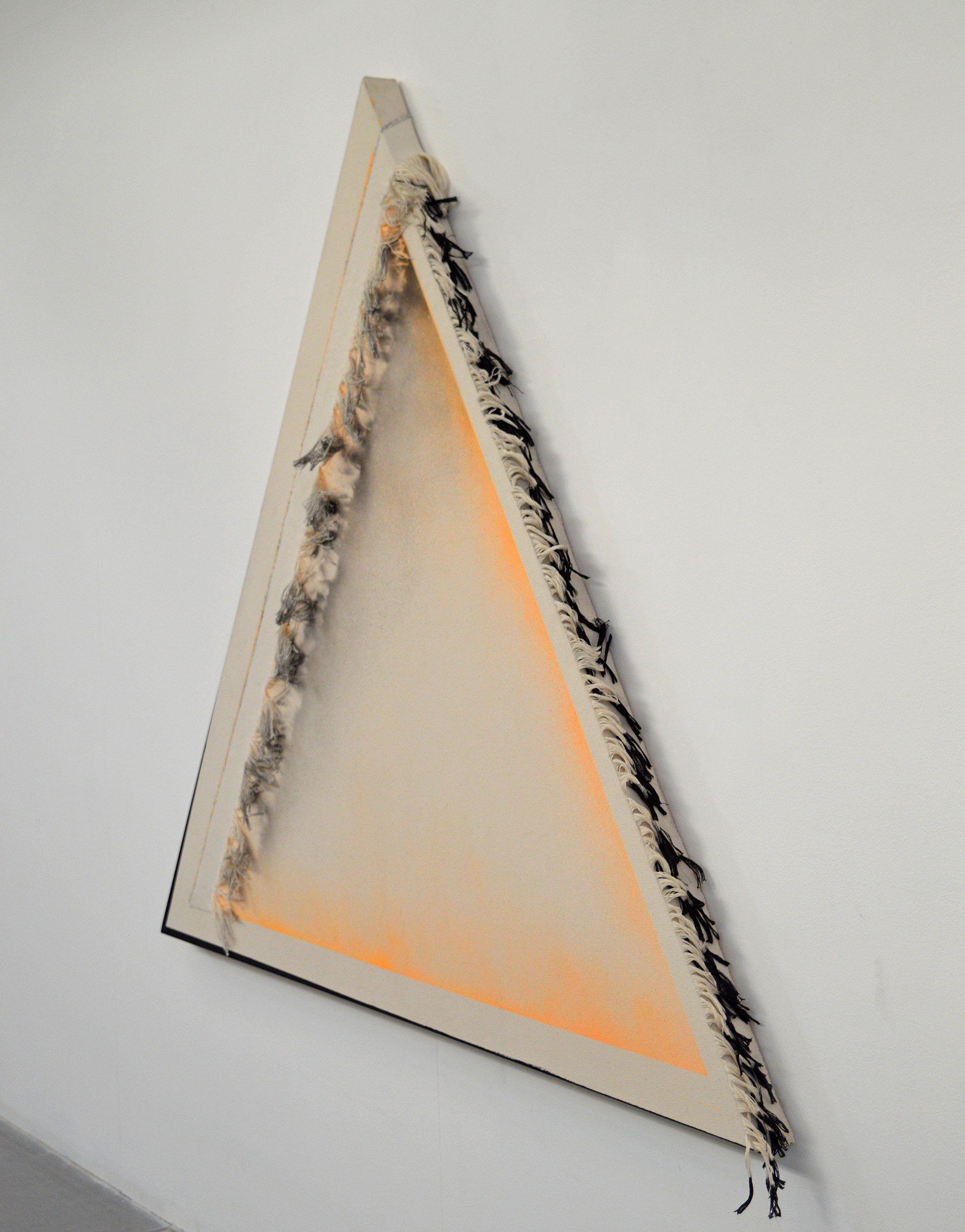 Andrea Medjesi-Jones , Bearded Triangle 1,  2015 Canvas fringing, acrylic and spray paint on canvas. Image courtesy of the artist and Backertrasse 4 Gallery, Vienna.